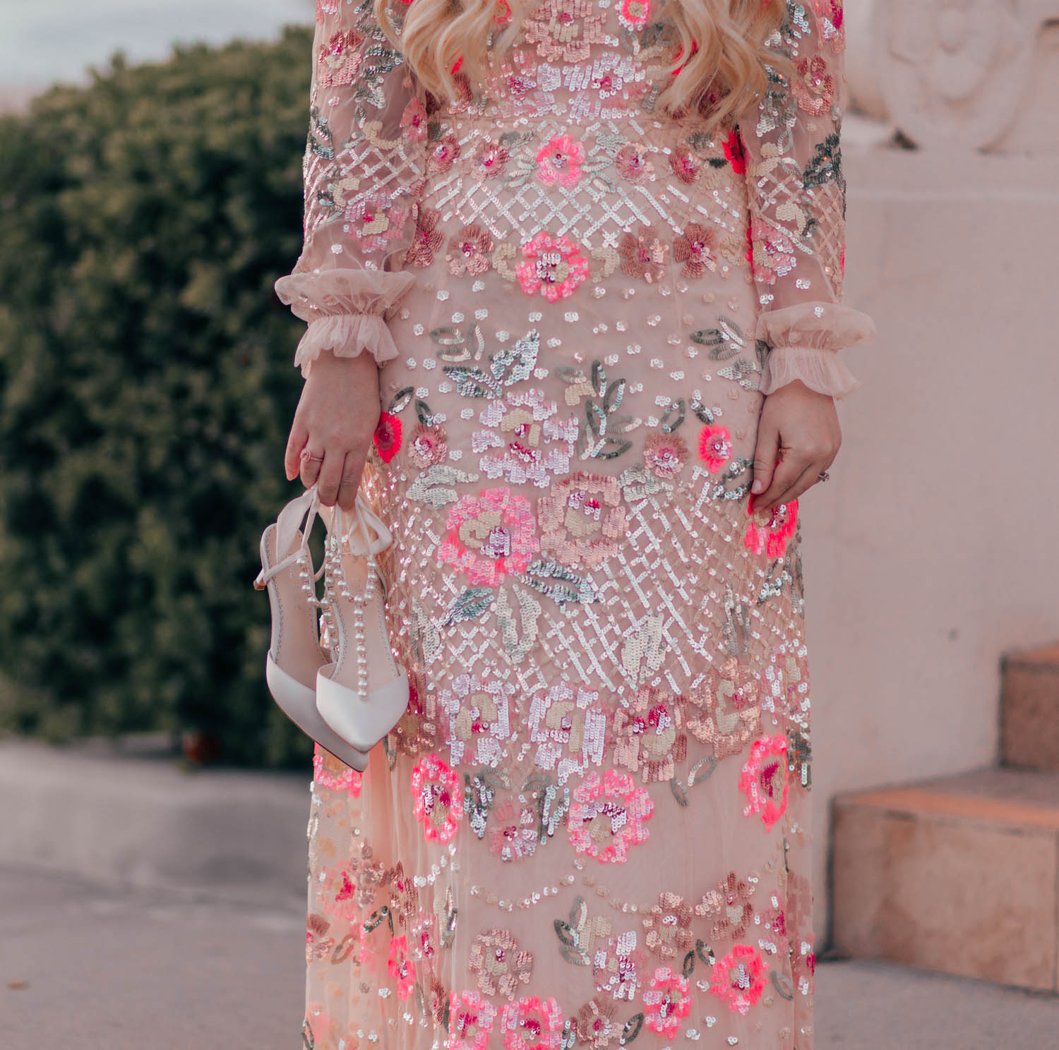 Elizabeth Hugen of Lizzie in Lace shares a floral sequin Needle and Thread dress and white pearl wedding heels along with her spring bucket list