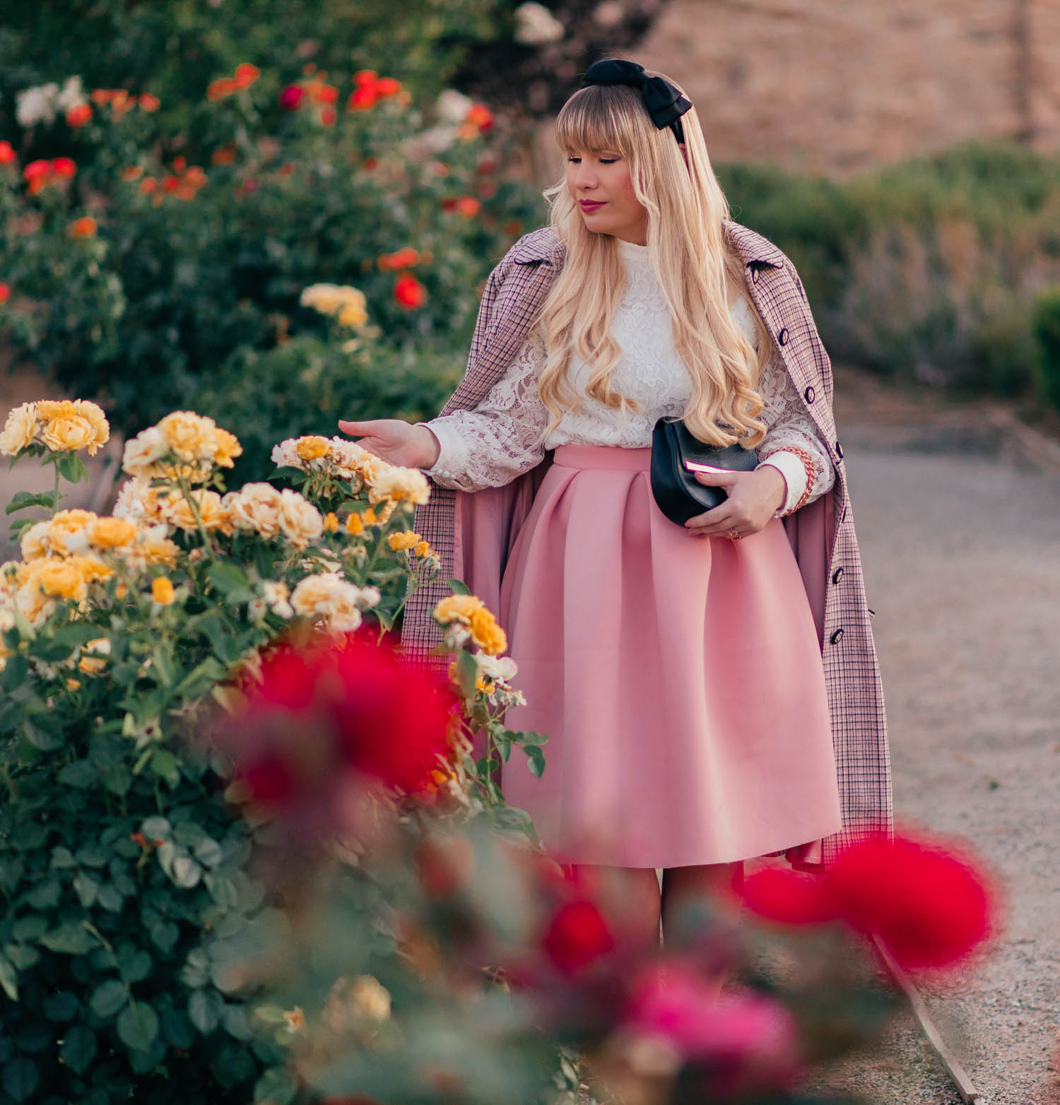 Elizabeth Hugen of Lizzie in Lace shares a pink feminine outfit idea