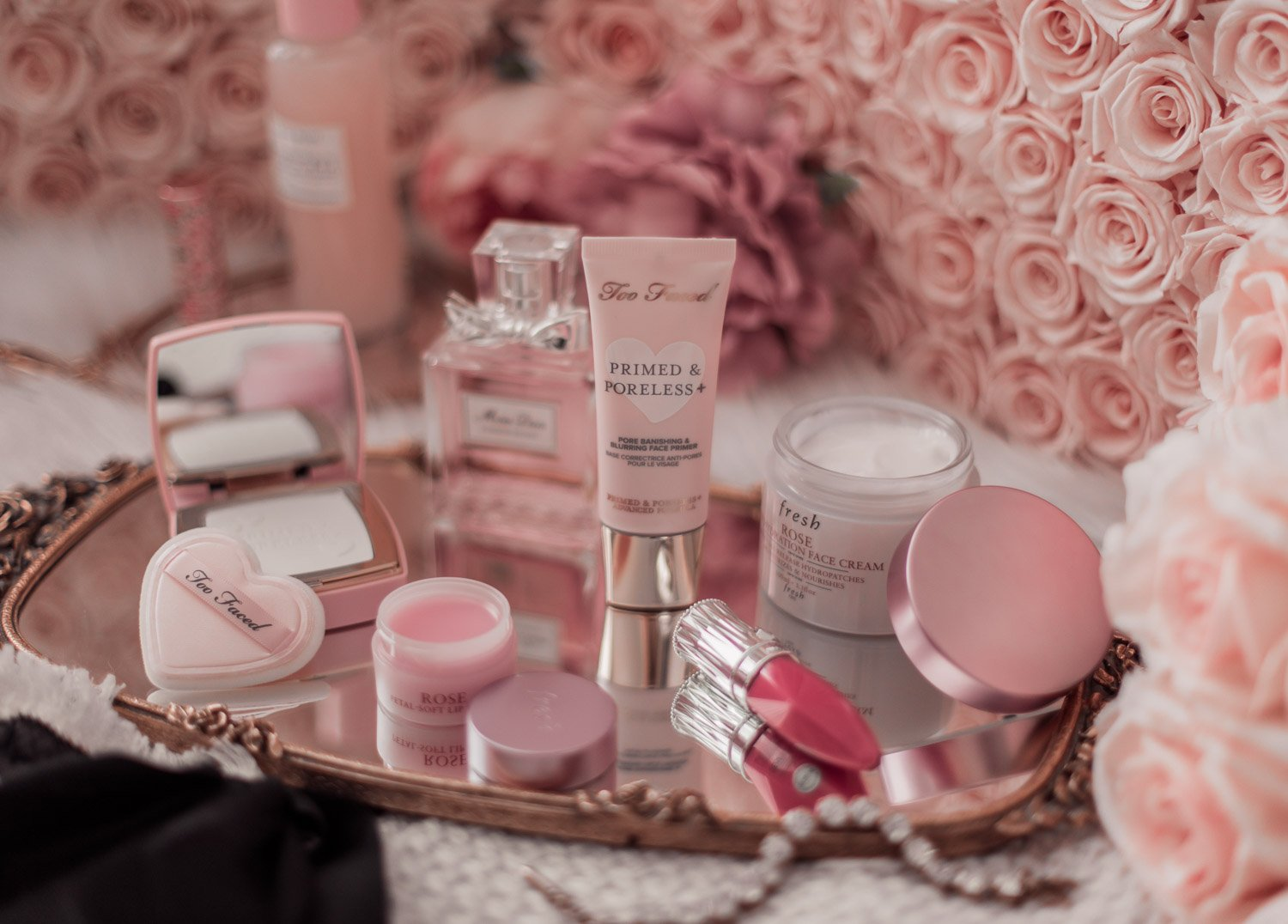 Elizabeth Hugen of Lizzie in Lace shares her must-have pink beauty products including Too Faced primed and poreless