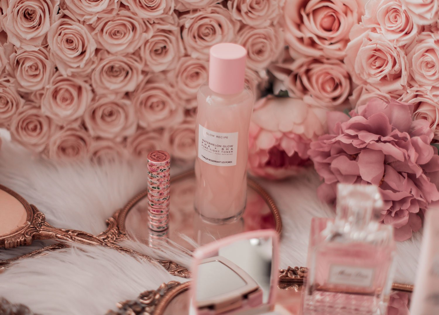 Elizabeth Hugen of Lizzie in Lace shares her must-have pink beauty products including the glow recipe watermelon toner