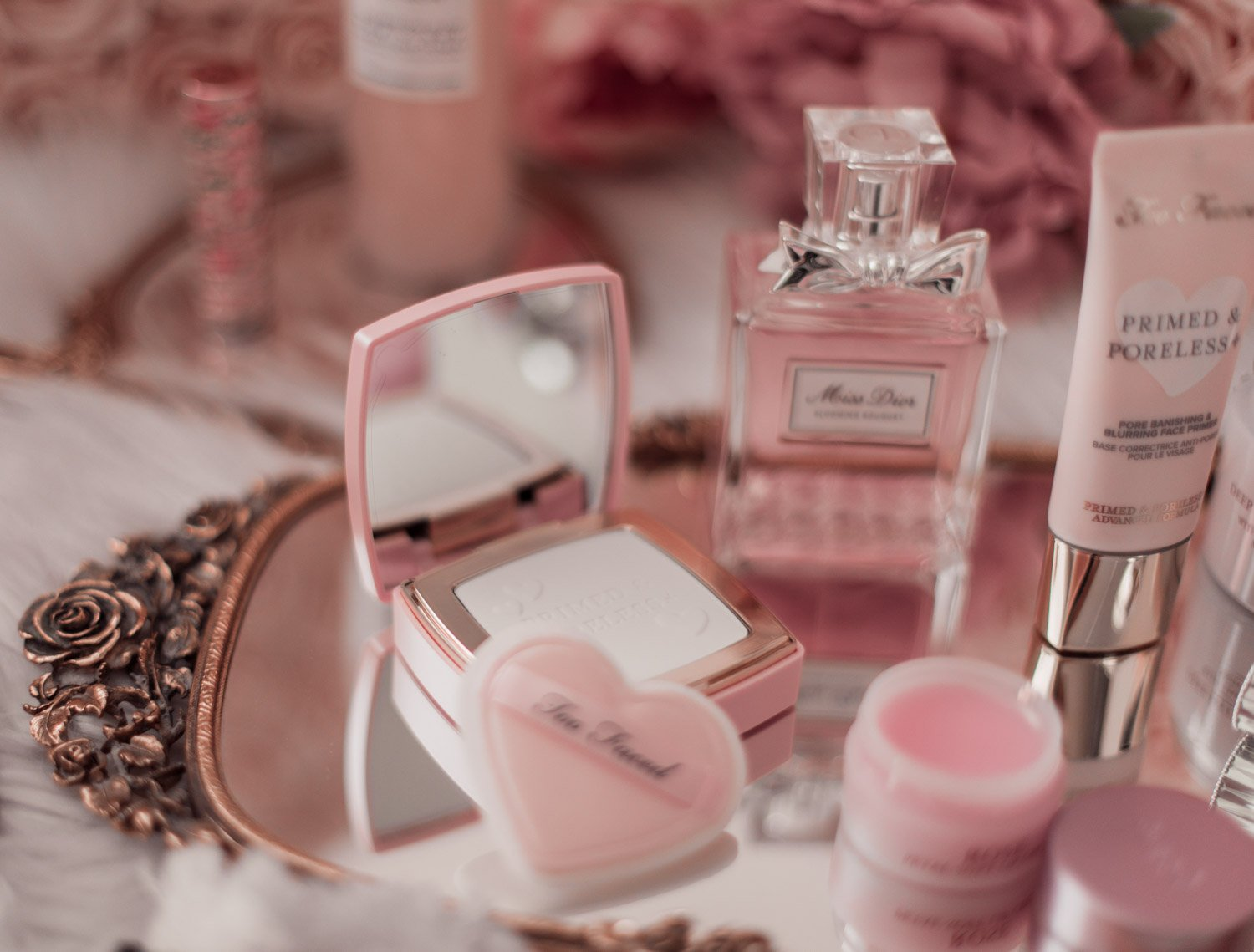 Elizabeth Hugen of Lizzie in Lace shares her must-have pink beauty products including the too faced primed and poreless powder