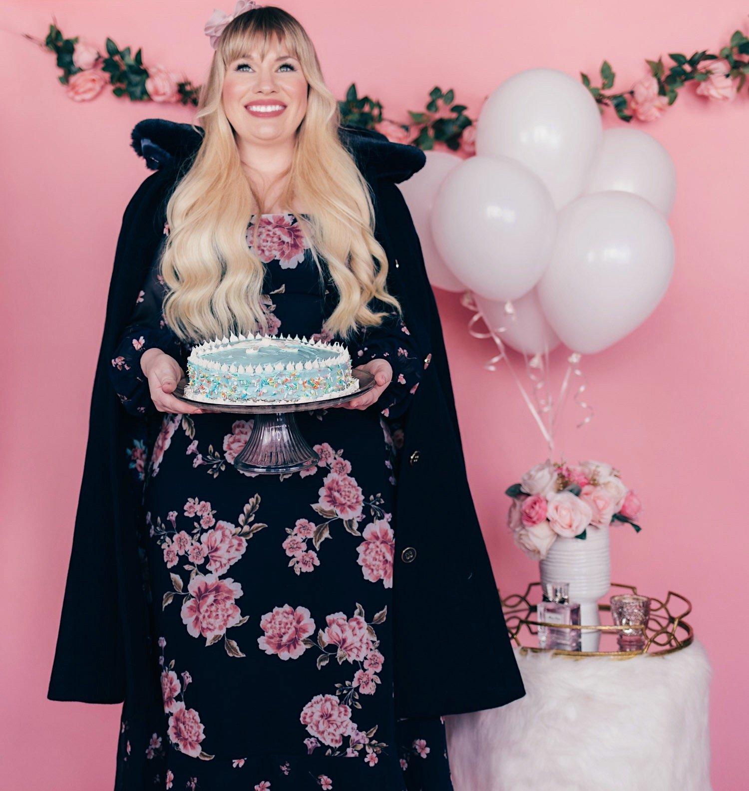 Fashion blogger Elizabeth Hugen wears a floral review Australia dress and navy faux fur coat
