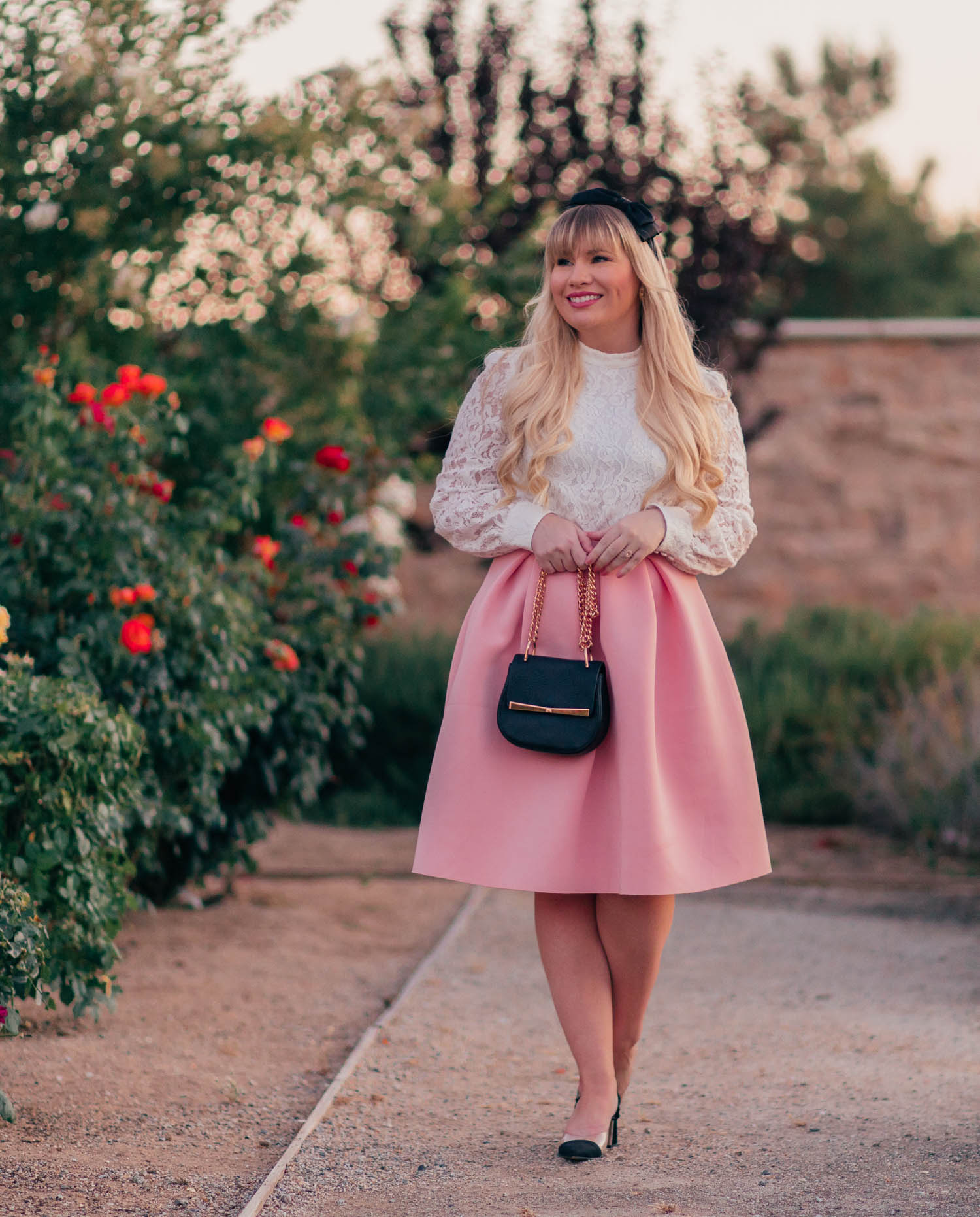 Fashion Blogger Elizabeth Hugen of Lizzie in Lace styles a white lace top with a pink skirt for gossip girl inspired style