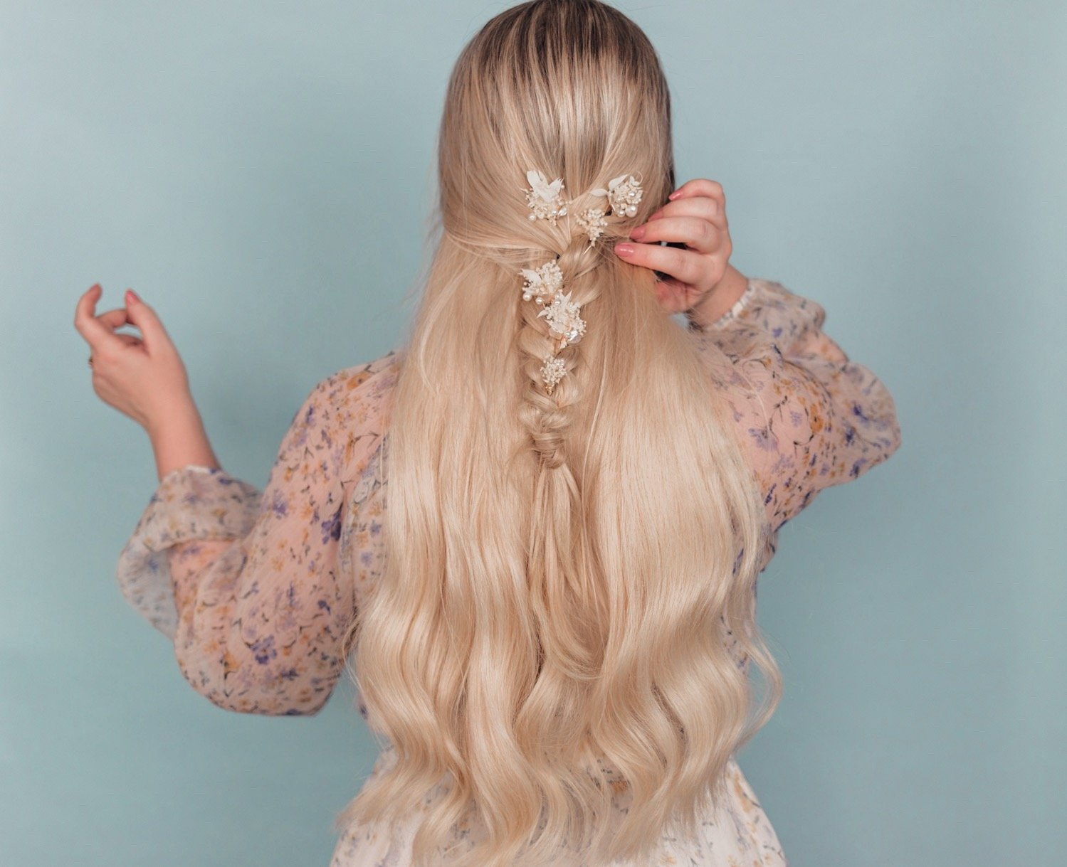 Elizabeth Hugen of Lizzie in Lace shares 5 simple summer hairstyles using hair accessories including beautiful floral pins placed in a boho braaid