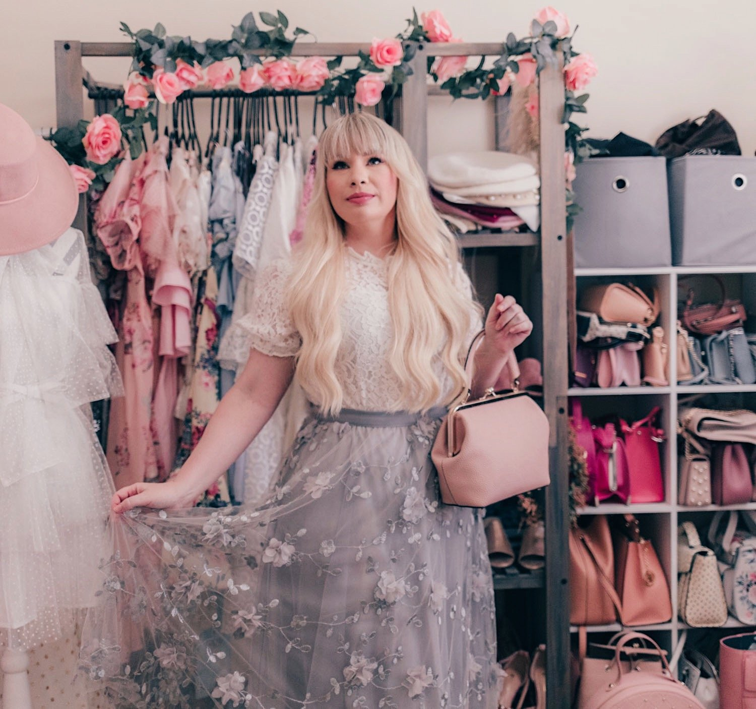 Fashion Blogger Elizabeth Hugen of Lizzie in Lace wears a white lace puff sleeve top and grey floral skirt from Chicwish