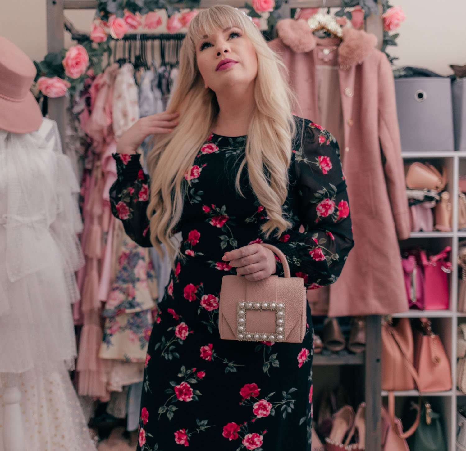 Fashion Blogger Elizabeth Hugen of Lizzie in Lace styles a black floral dress and pink Kate Spade bag