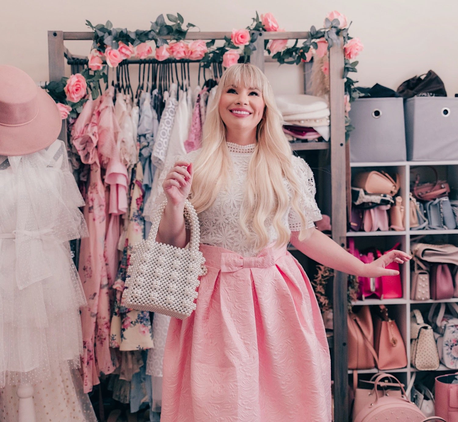 Fashion Blogger Elizabeth Hugen of Lizzie in Lace wears a white lace puff sleeve top and pink bow skirt from Chicwish