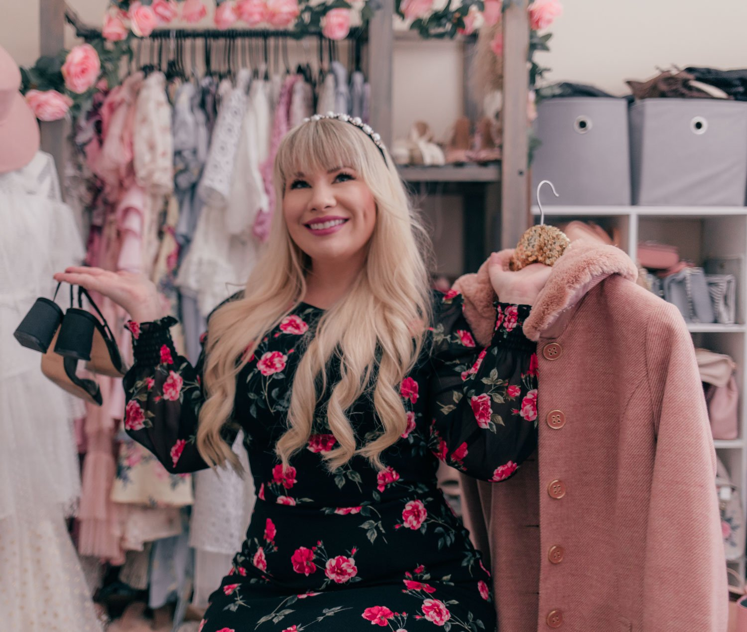 Fashion Blogger Elizabeth Hugen of Lizzie in Lace styles a black floral dress and shares her feminine pink closet
