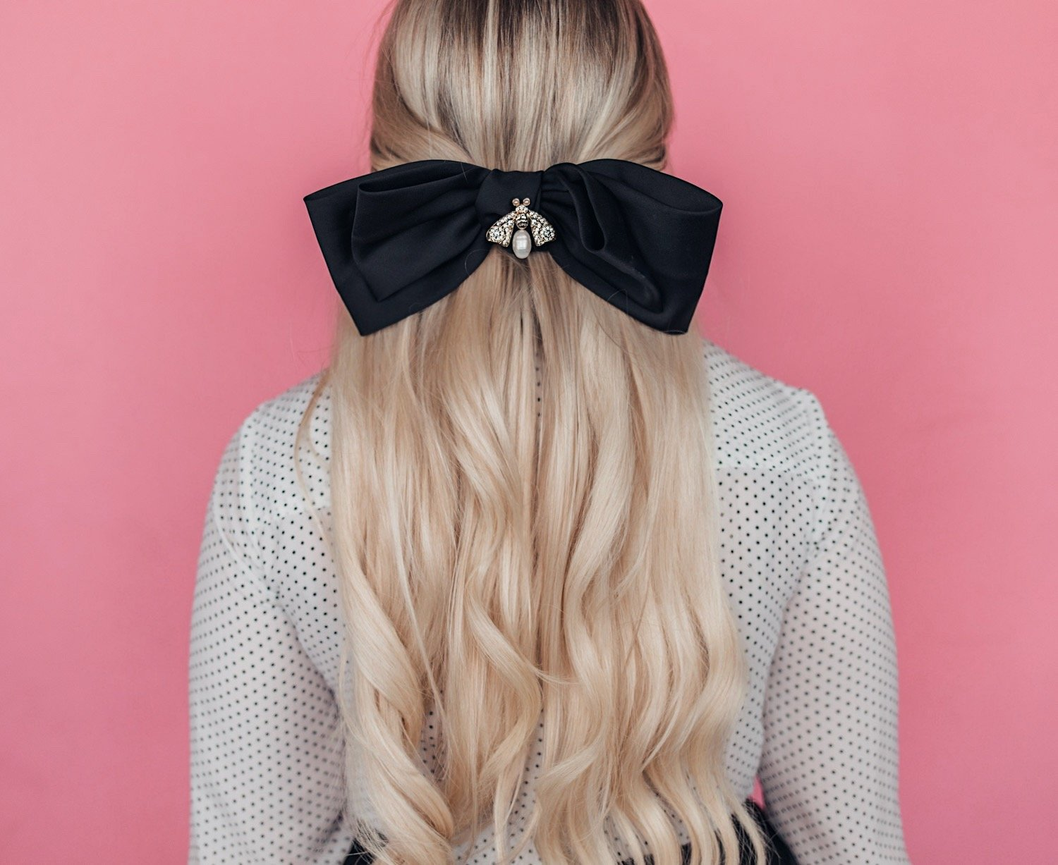 Fashion blogger Elizabeth Hugen of Lizzie in Lace shares creative ways to wear earrings without pierced ears including a feminine bow hairstyle