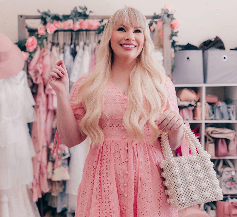 Fashion Blogger Elizabeth Hugen of Lizzie in Lace wears a pink crochet summer dress from Chicwish