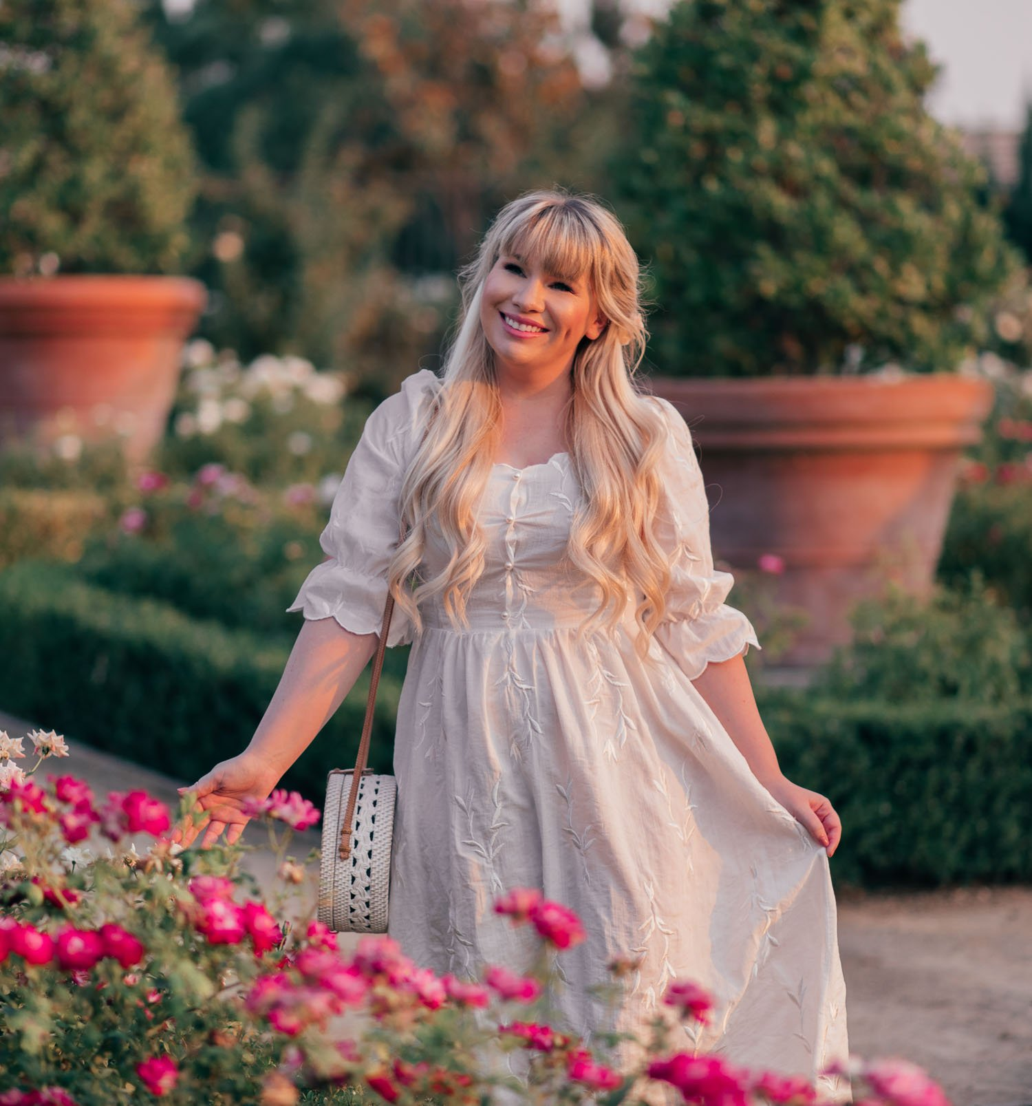 Fashion Blogger Elizabeth Hugen from Lizzie in Lace shares a feminine white dress for summer and fall