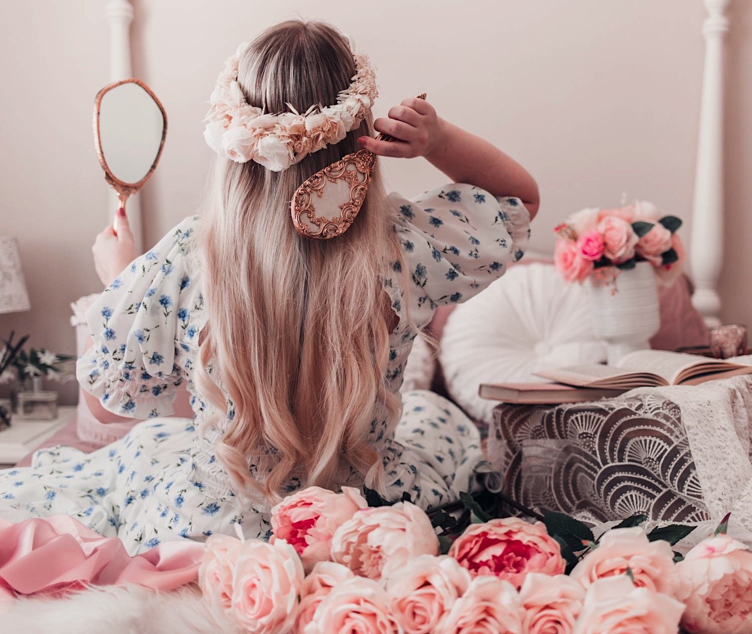 Fashion blogger Elizabeth Hugen wears a Les Couronnes flower crown and Sister Jane floral dress