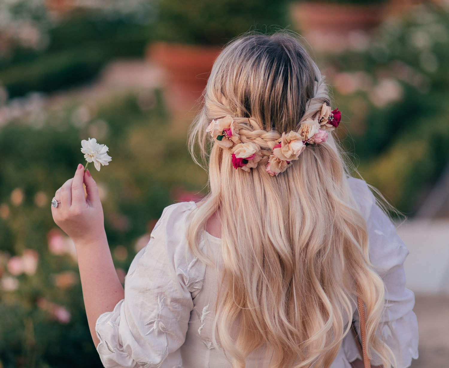 Fashion Blogger Elizabeth Hugen from Lizzie in Lace shares a feminine floral braided crown hairstyle
