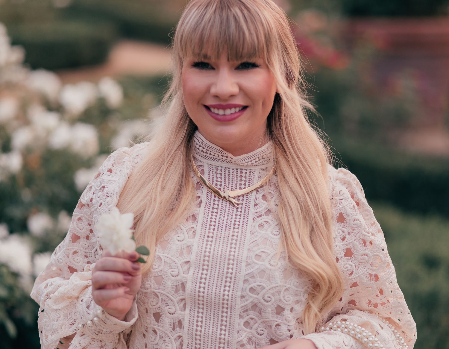 Fashion Blogger Elizabeth Hugen of Lizzie in Lace shares a Feminine White Monochrome Outfit for Fall and a UNOde50 necklace