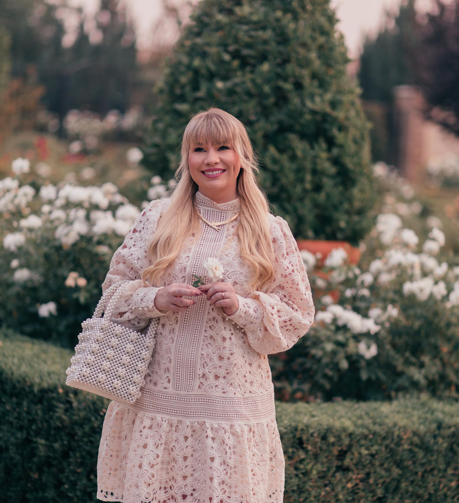 Fashion Blogger Elizabeth Hugen of Lizzie in Lace shares a Feminine White Monochrome Outfit for Fall and a lace H&M dress