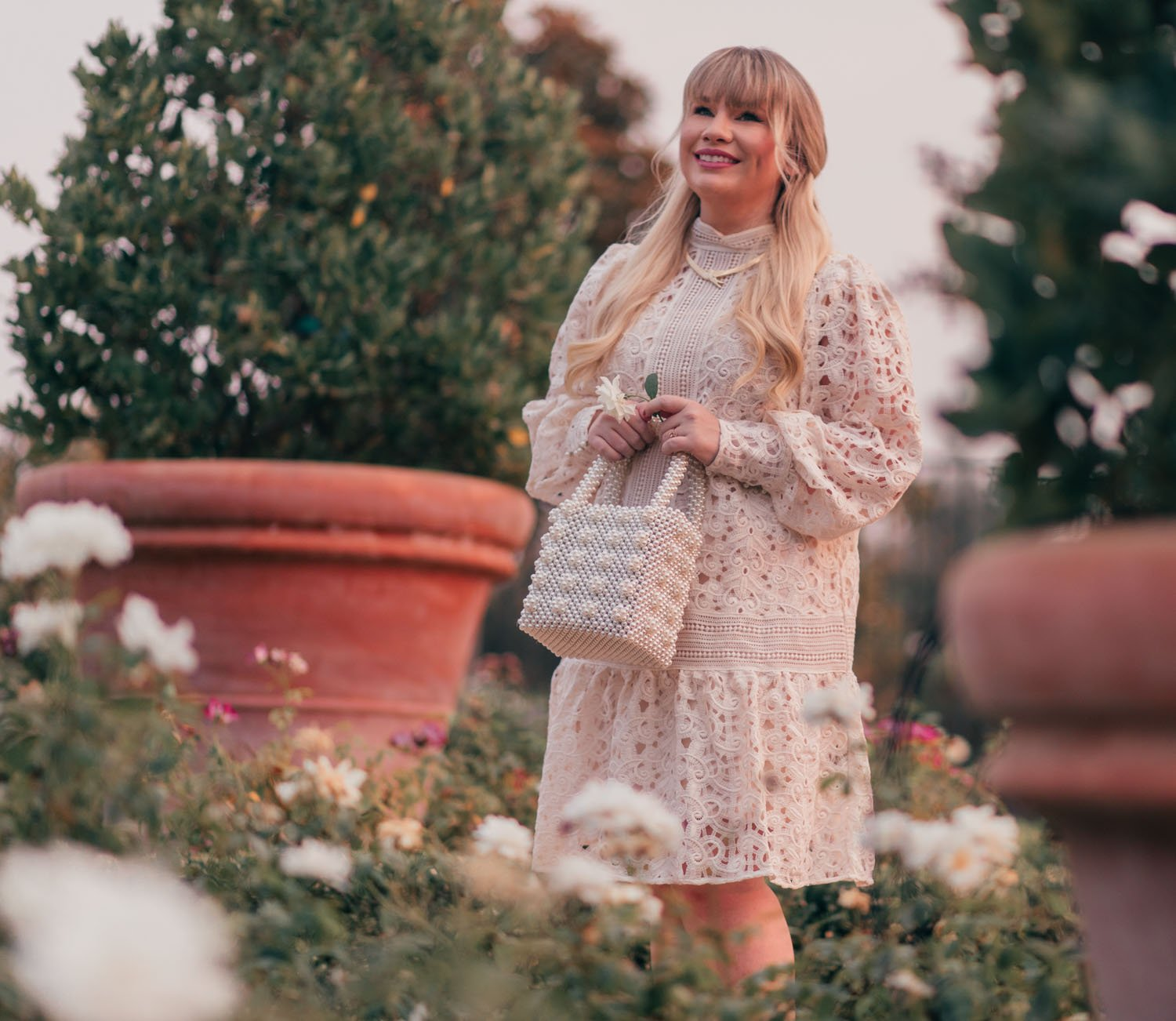 Fashion Blogger Elizabeth Hugen of Lizzie in Lace shares a Feminine White Monochrome Outfit for Fall