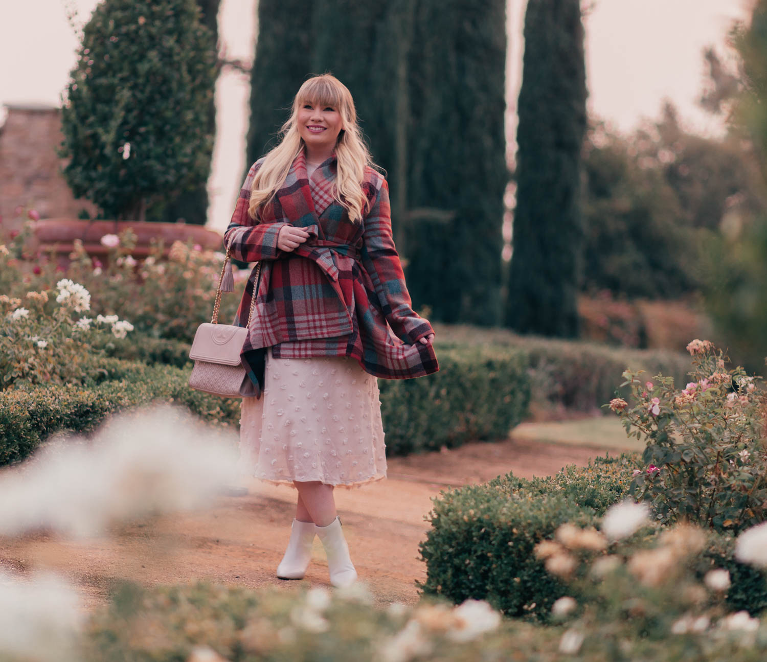 Fashion Blogger Elizabeth Hugen of Lizzie in Lace styles a cozy fall outfit including a plaid Chicwish coat, cream midi dress, white Franco Sarto Boots and a Tory Burch Fleming handbag