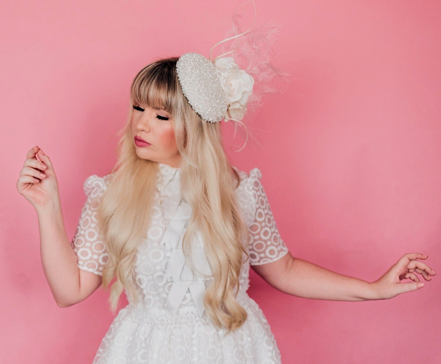 Fashion Blogger Elizabeth Hugen of Lizzie in Lace wear a white dress with bows and white floral Merve Bayindir hat