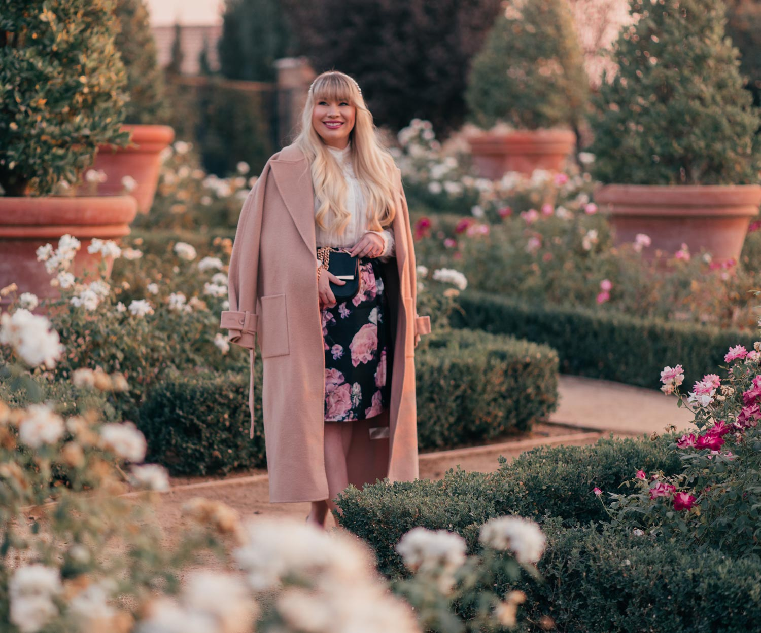 Fashion Blogger Elizabeth Hugen of Lizzie in Lace share 7 Tips for Mastering French Girl Style along with her gorgeous nude BA&SH coat and white BA&SH eyelet top
