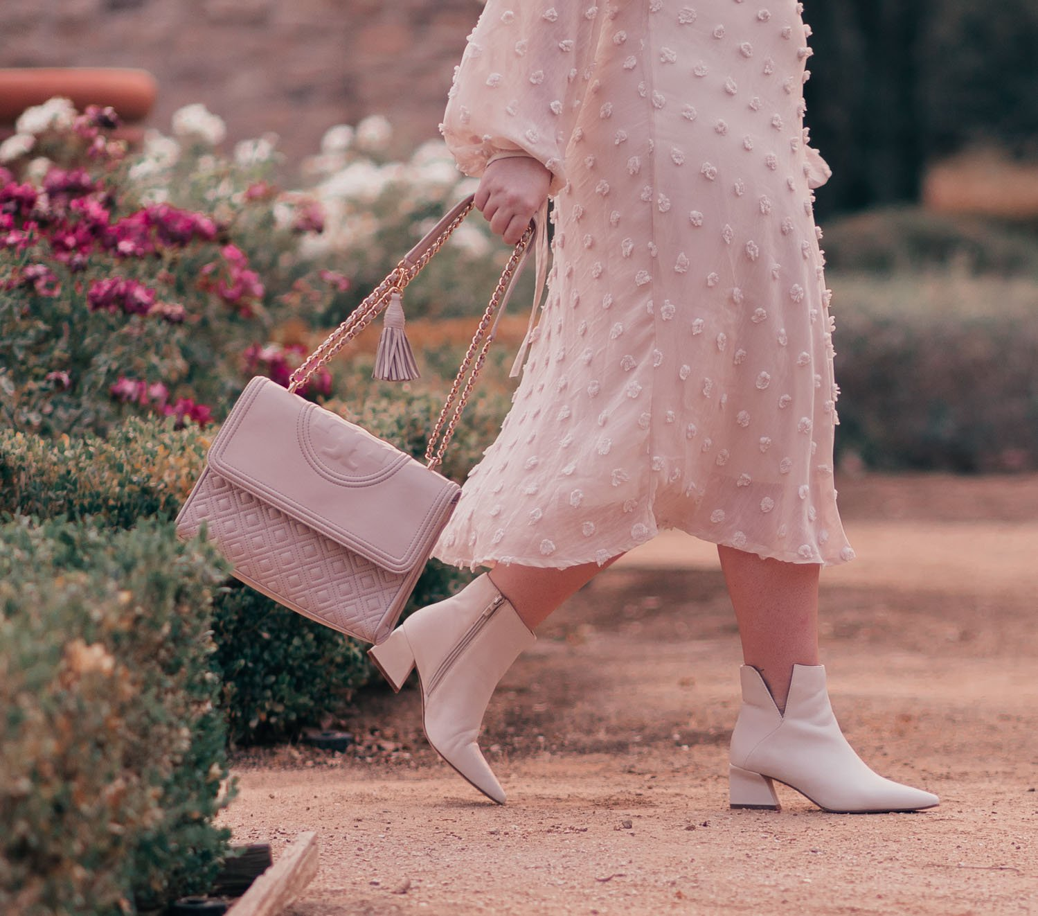Fashion Blogger Elizabeth Hugen of Lizzie in Lace styles a cozy fall outfit including a Chicwish cream midi dress, white Franco Sarto Boots and a Tory Burch Fleming handbag