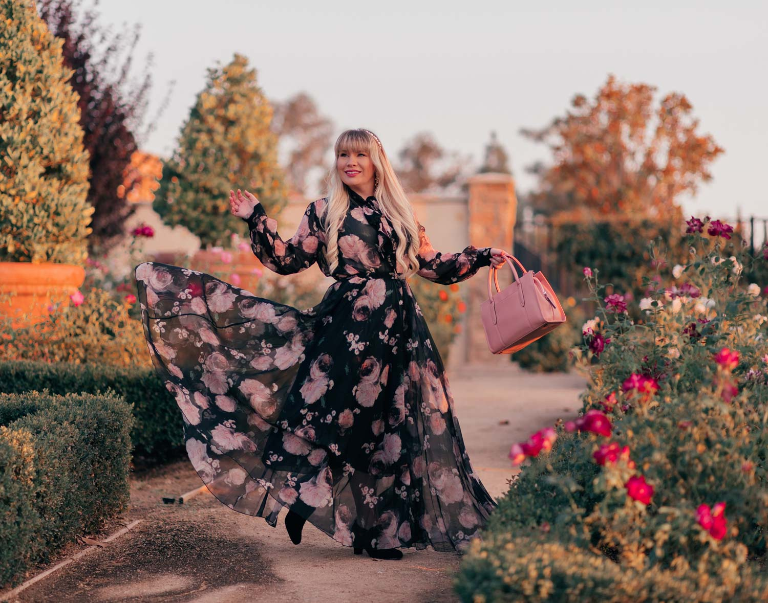 Fashion Blogger Elizabeth Hugen of Lizzie in Lace shares an aesthetic outfit idea with a black floral dress for fall