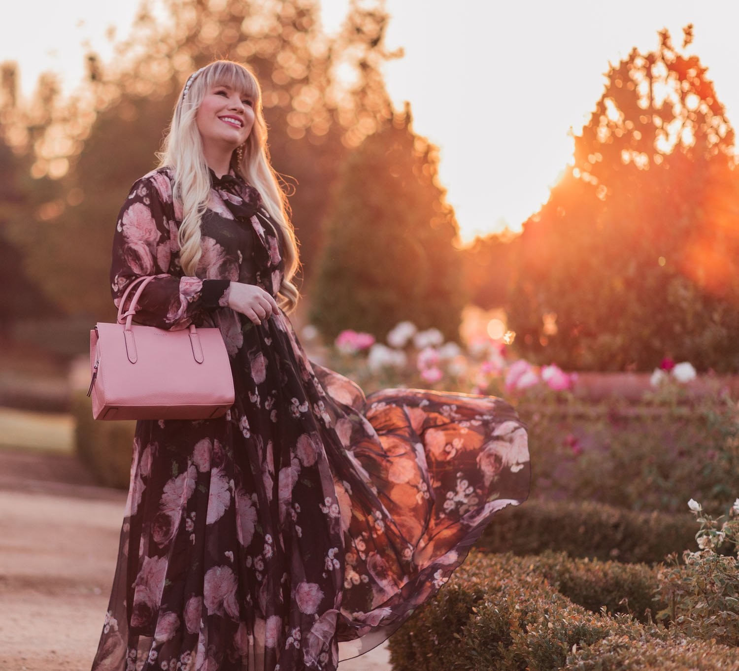 Fashion Blogger Elizabeth Hugen of Lizzie in Lace shares an aesthetic outfit idea with a black floral set for fall