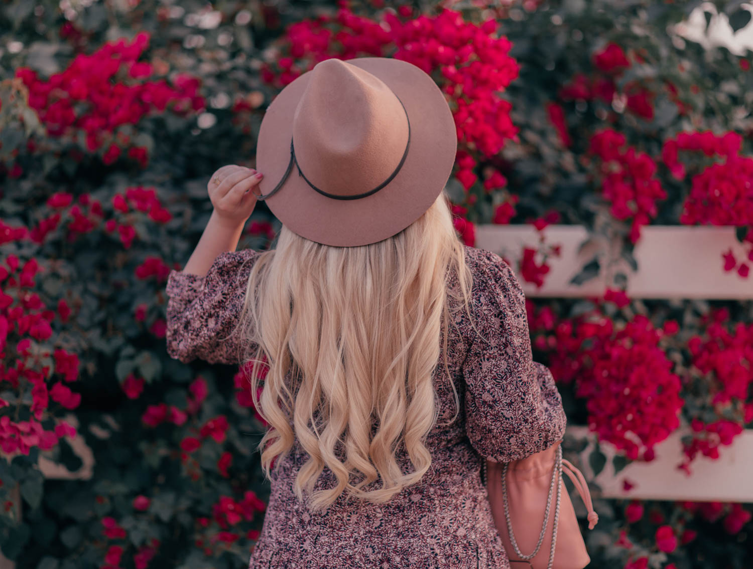 Fashion blogger Elizabeth Hugen of Lizzie in Lace share a Fall Prairie Dress Outfit Idea including a BASH dress and anthropologie hat