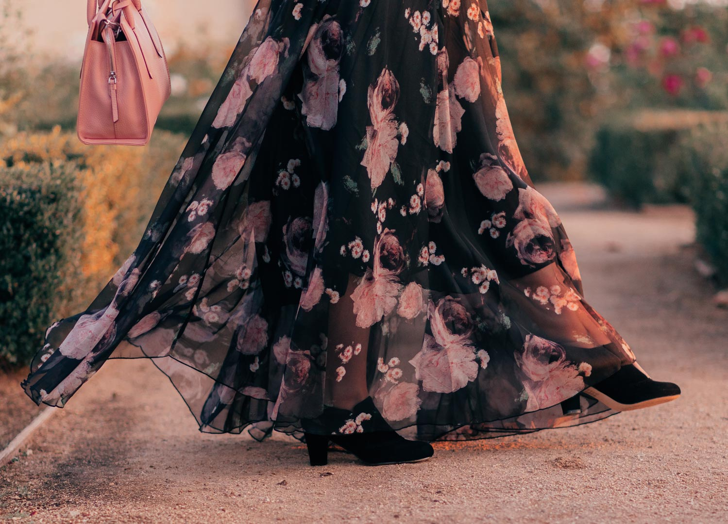 Fashion Blogger Elizabeth Hugen of Lizzie in Lace shares an aesthetic outfit idea with a black floral skirt and vintage inspired shoes for fall