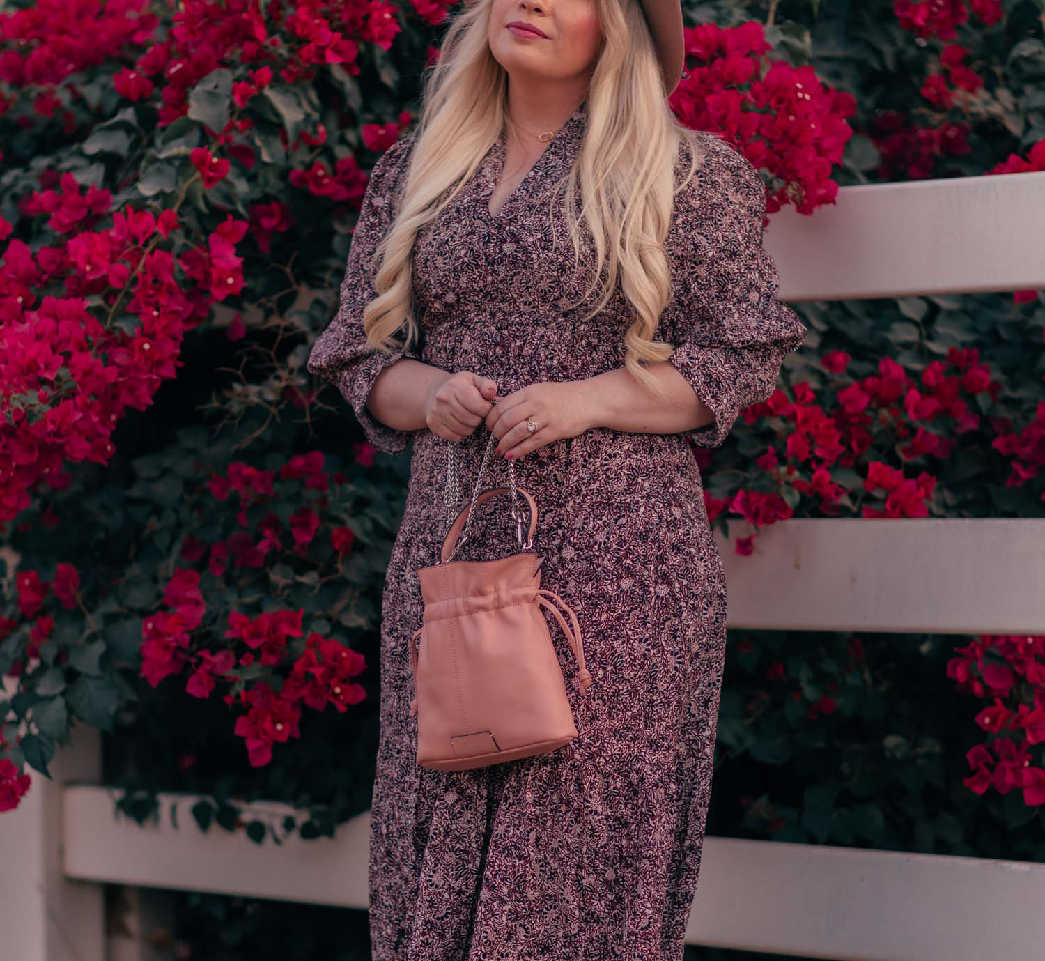 Fashion blogger Elizabeth Hugen of Lizzie in Lace share a Fall Prairie Dress Outfit Idea including a BASH dress and Radley London handbag