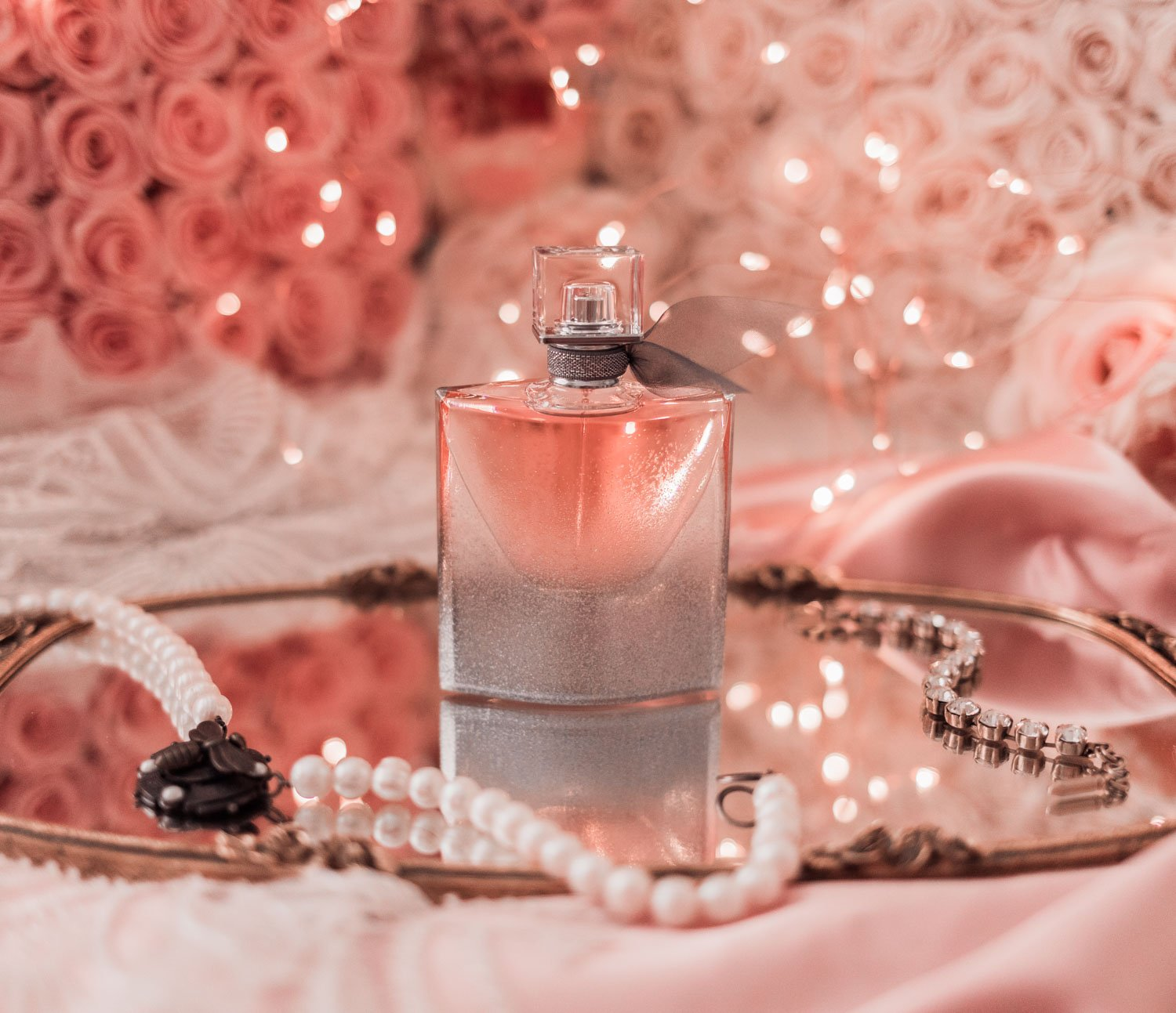 Fashion Blogger Elizabeth Hugen of Lizzie in Lace shares her Pretty Pink Holiday Gift Guide including this Lancome La Vie est Belle fragrance