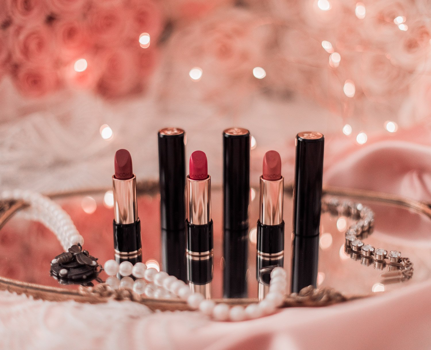 Fashion Blogger Elizabeth Hugen of Lizzie in Lace shares her Pretty Pink Holiday Gift Guide including these gorgeous Lancome lipstick set
