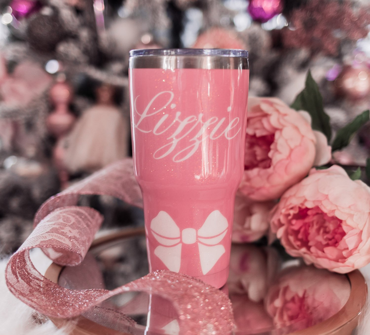 Fashion Blogger Elizabeth Hugen shares her Girly Girl Holiday Gift Guide including a pink bow tumbler