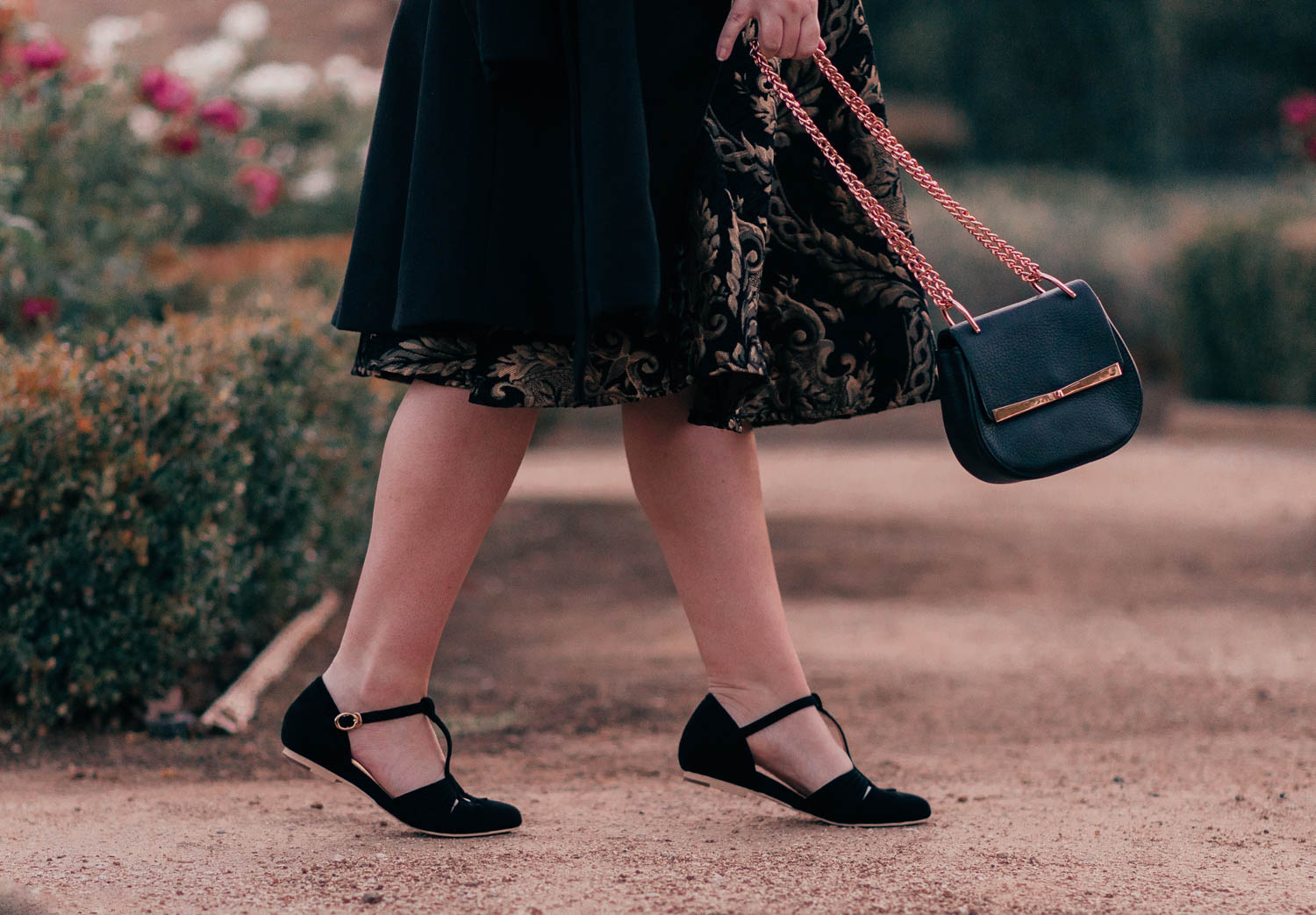 Fashion Blogger Elizabeth Hugen shares an elegant black holiday outfit idea including these charlie stone flats