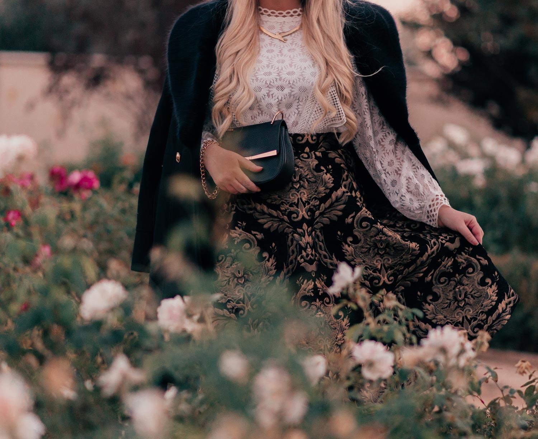 Fashion Blogger Elizabeth Hugen shares an elegant black holiday outfit idea