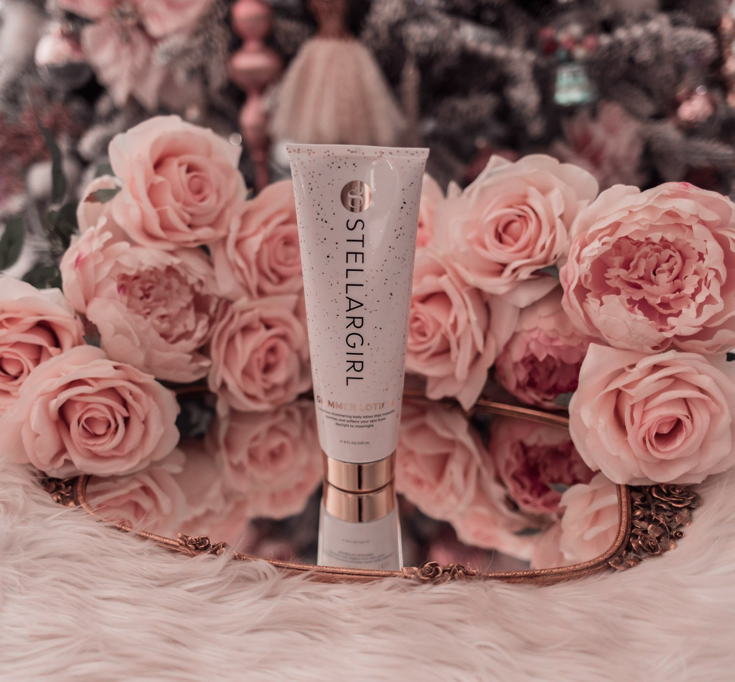 Fashion Blogger Elizabeth Hugen of Lizzie in Lace shares holiday beauty gifts to gift yourself including this fun Stellargirl Glimmer lotion