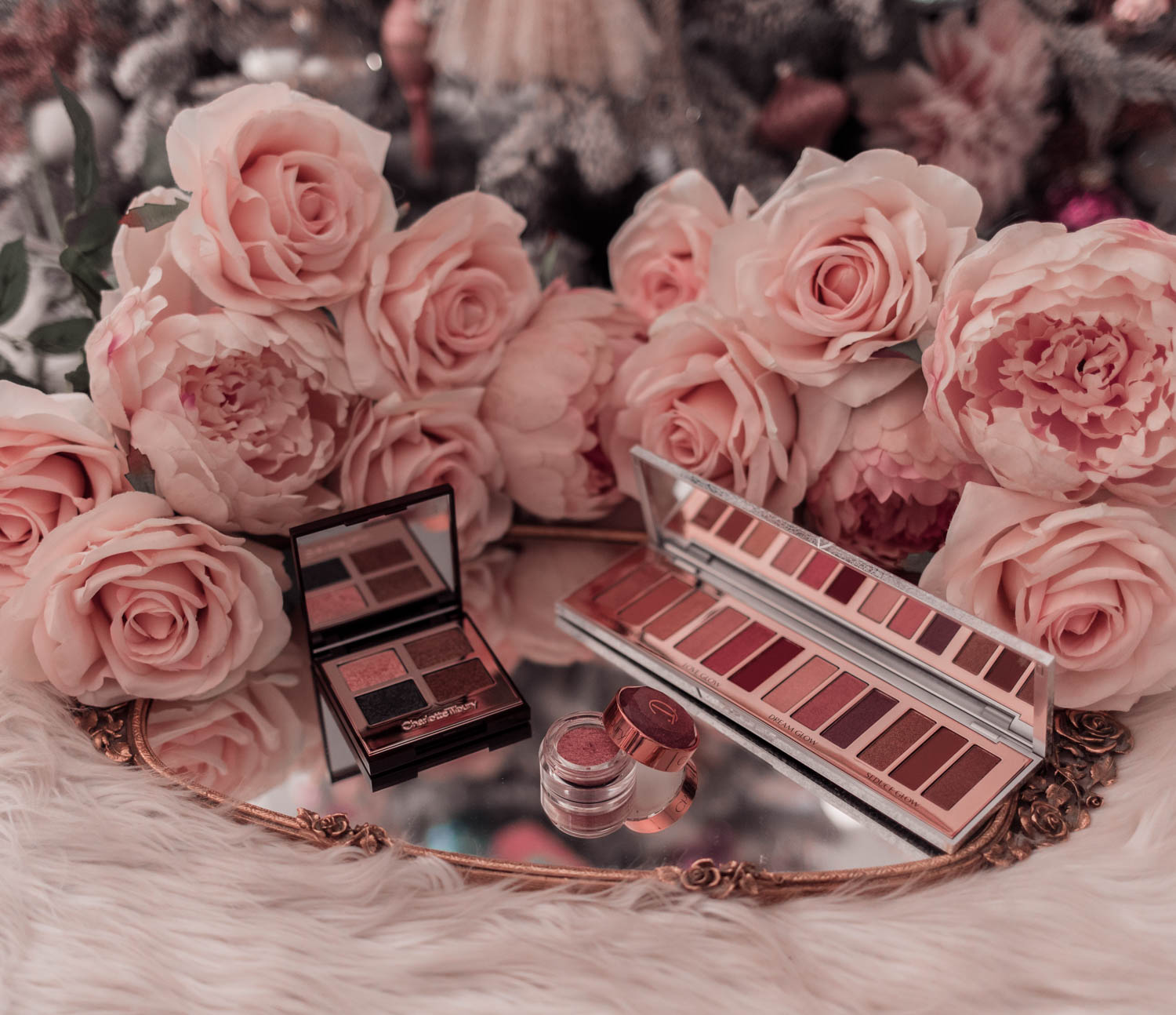 Fashion Blogger Elizabeth Hugen of Lizzie in Lace shares holiday beauty gifts to gift yourself including these glamorous Charlotte Tilbury eye shadow palettes