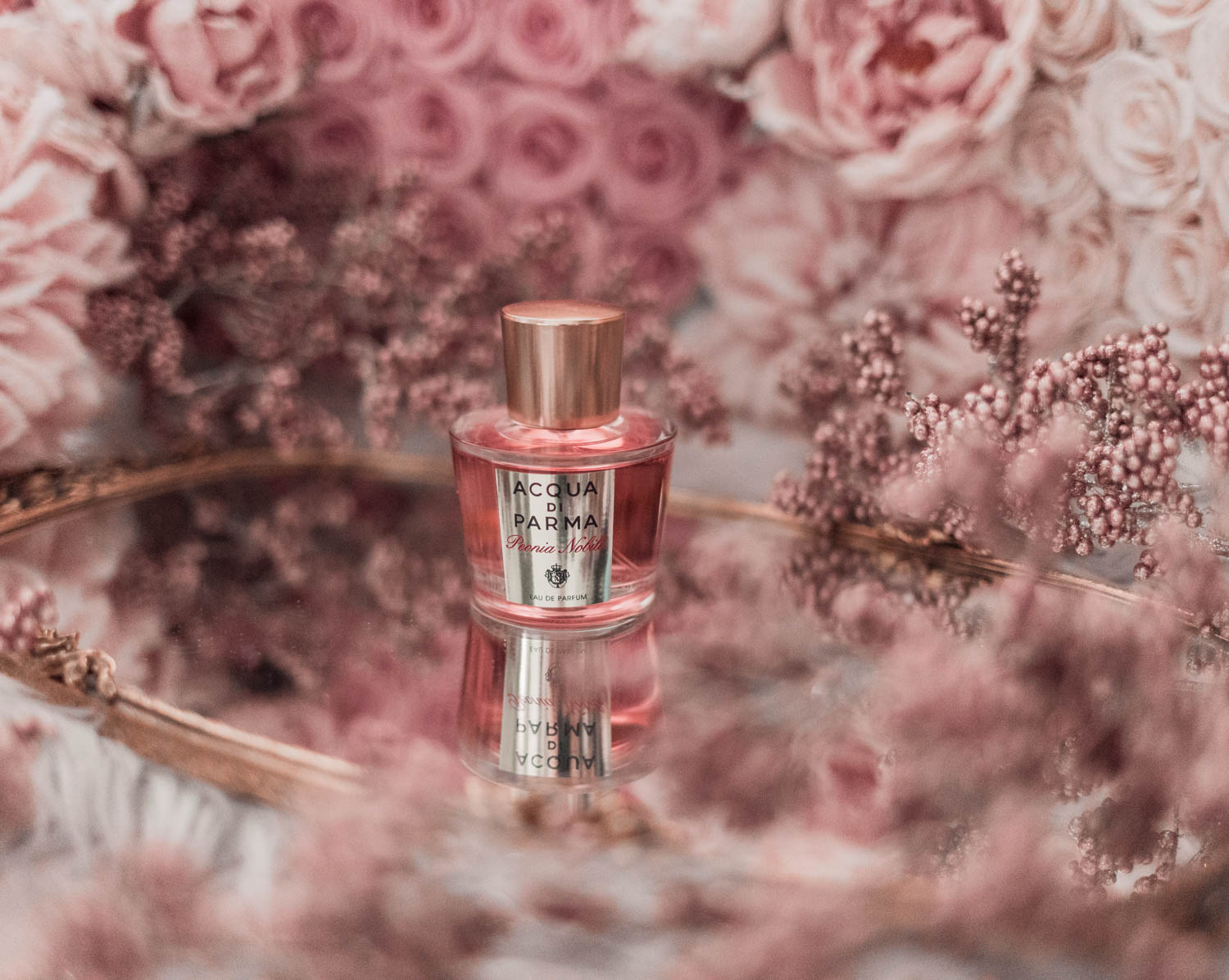 Feminine fashion blogger Elizabeth Hugen of Lizzie in Lace shares the best feminine perfumes and her girly fragrance collection including Acqua di Parma Peonia Nobile