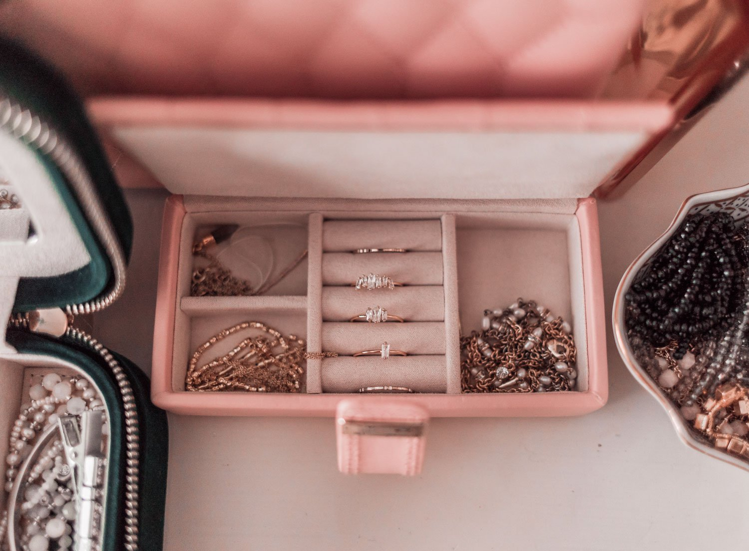 Fashion Blogger Elizabeth Hugen of Lizzie in Lace shares her girly jewelry collection and how she organizes it in her pink jewelry box