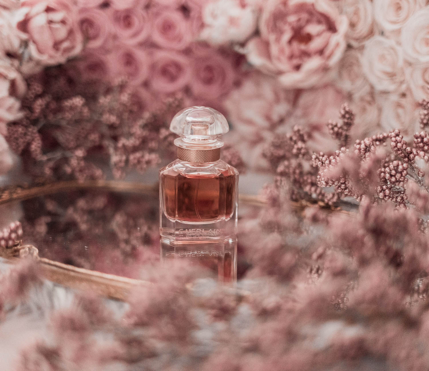 Feminine fashion blogger Elizabeth Hugen of Lizzie in Lace shares the best feminine perfumes and her girly fragrance collection including Guerlain Mon Guerlain