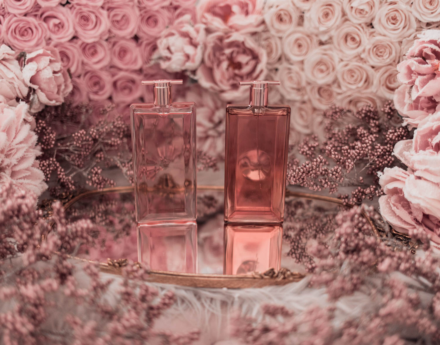 Feminine fashion blogger Elizabeth Hugen of Lizzie in Lace shares the best feminine perfumes and her girly fragrance collection including Lancome Idole