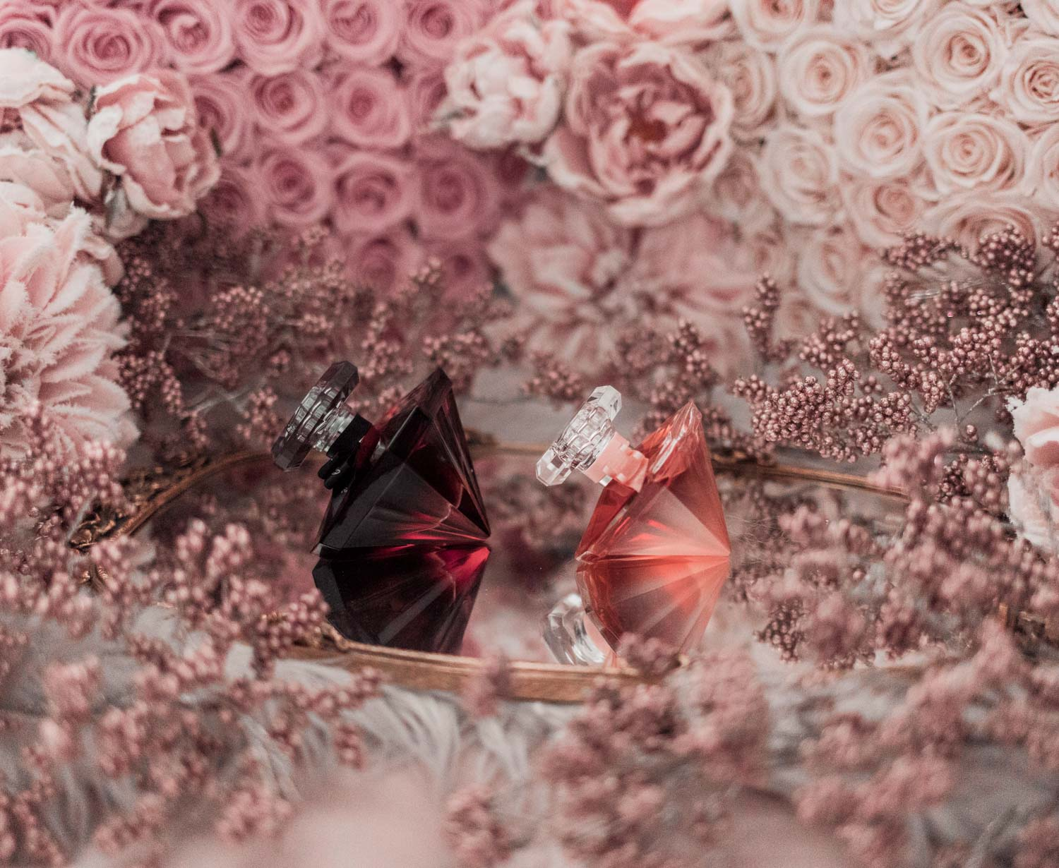 Feminine fashion blogger Elizabeth Hugen of Lizzie in Lace shares the best feminine perfumes and her girly fragrance collection including Lancome La Nuit Tresor