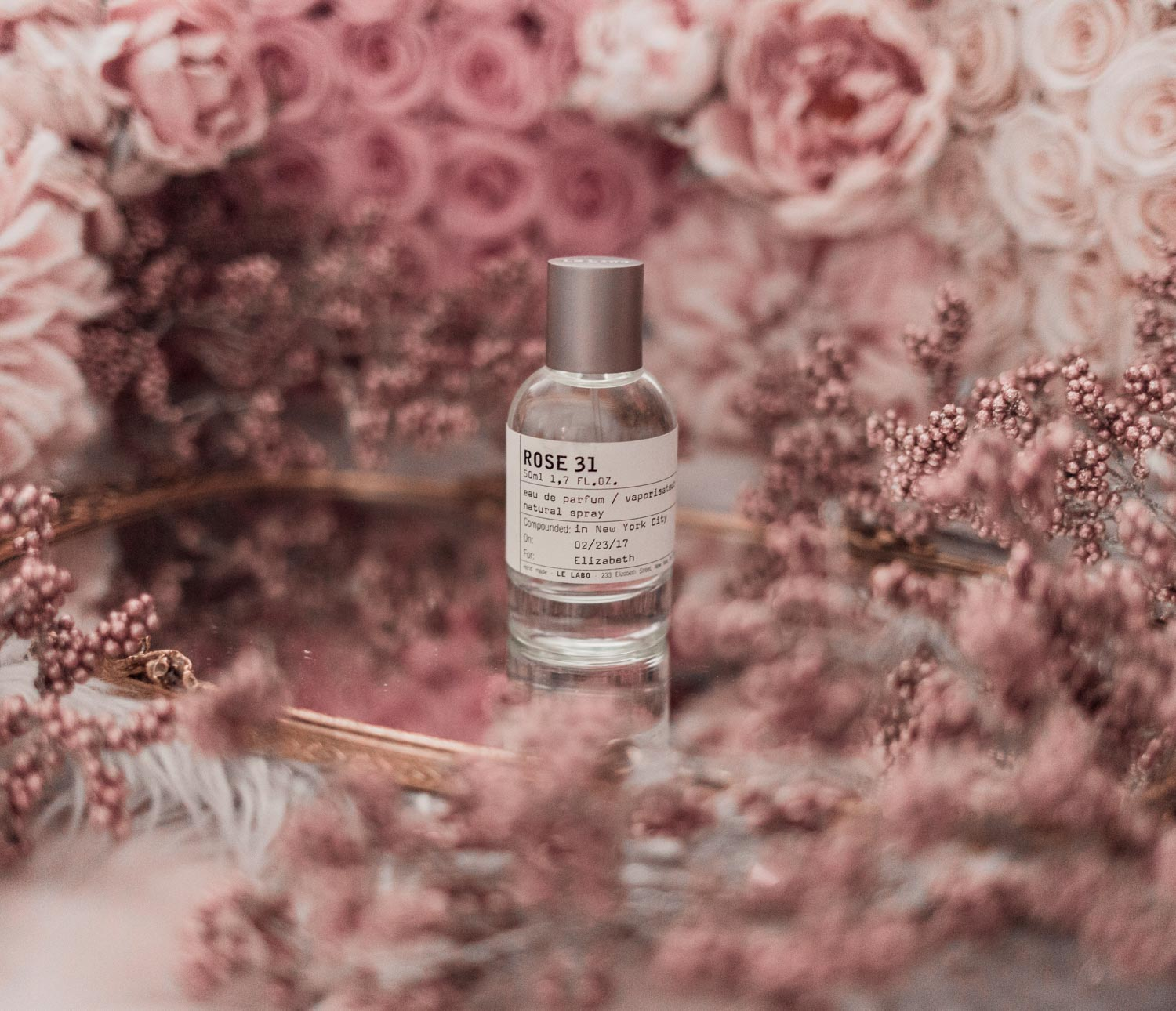 Feminine fashion blogger Elizabeth Hugen of Lizzie in Lace shares the best feminine perfumes and her girly fragrance collection including Le Labo Rose 31