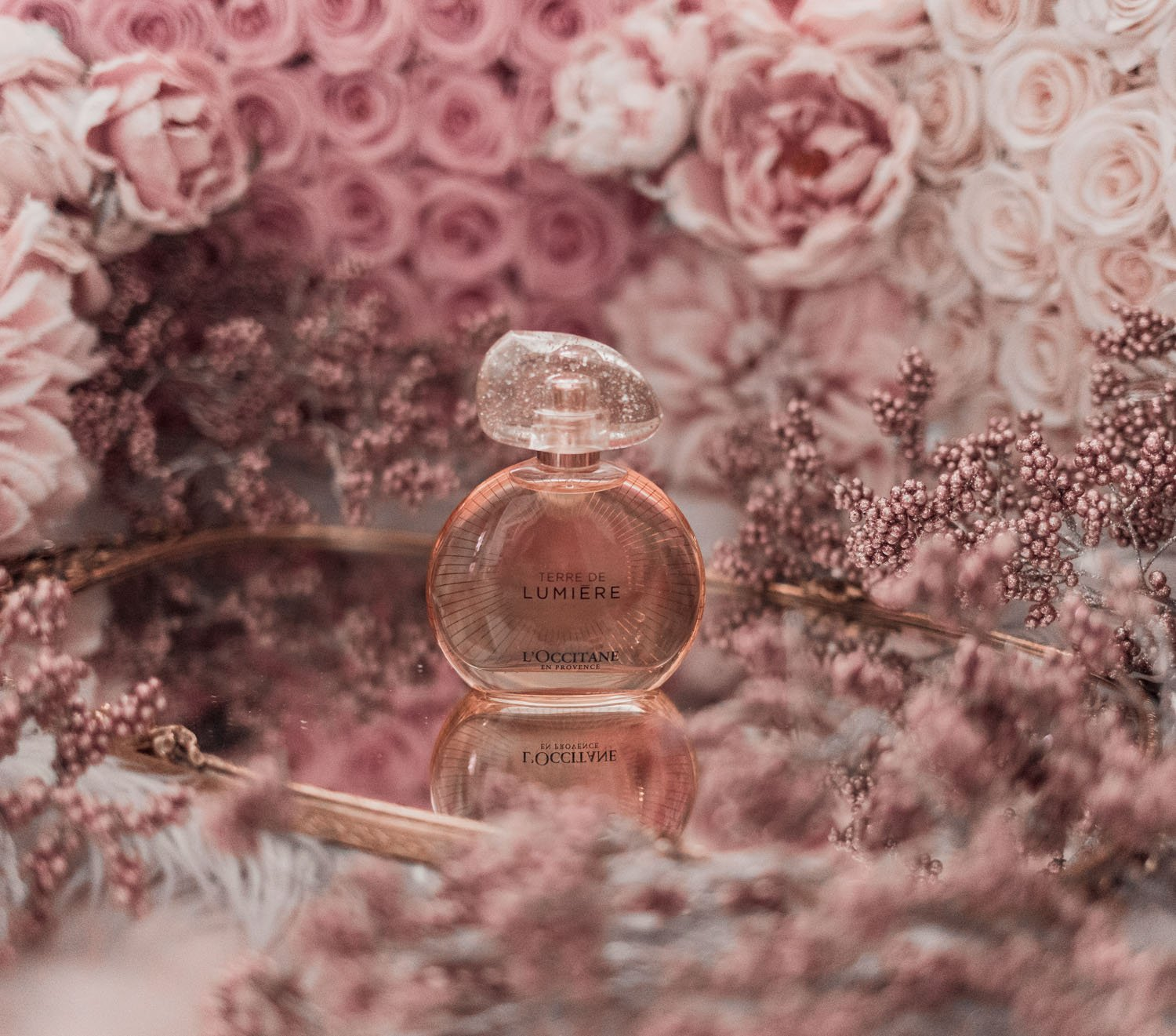 Feminine fashion blogger Elizabeth Hugen of Lizzie in Lace shares the best feminine perfumes and her girly fragrance collection including L'Occitane Terre de Lumiere