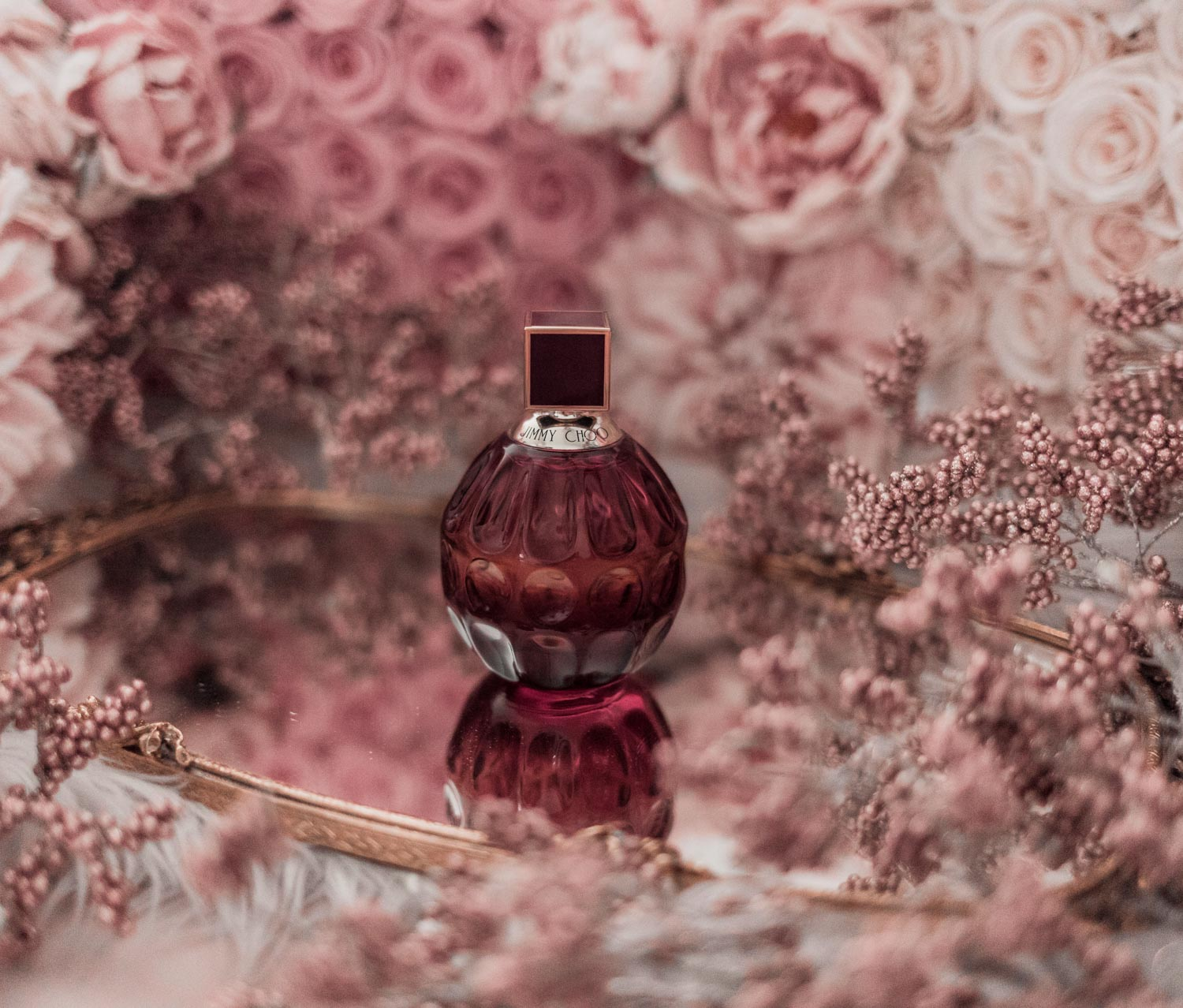Feminine fashion blogger Elizabeth Hugen of Lizzie in Lace shares the best feminine perfumes and her girly fragrance collection including Jimmy Choo Fever