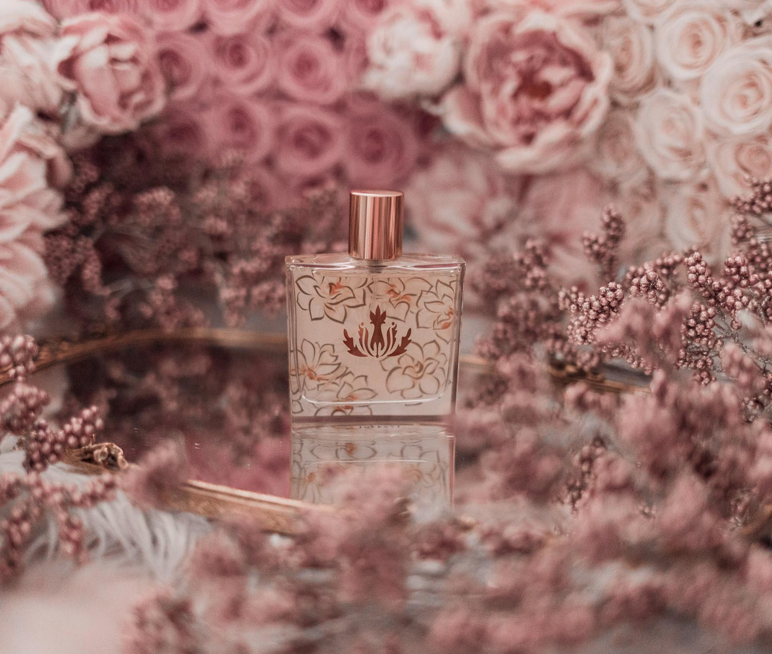 Feminine fashion blogger Elizabeth Hugen of Lizzie in Lace shares the best feminine perfumes and her girly fragrance collection including Malie Pikake
