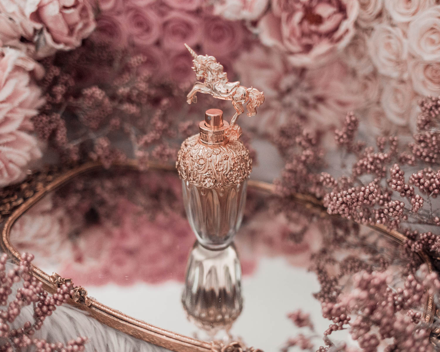 Feminine fashion blogger Elizabeth Hugen of Lizzie in Lace shares the best feminine perfumes and her girly fragrance collection including Anna Sui Fantasia