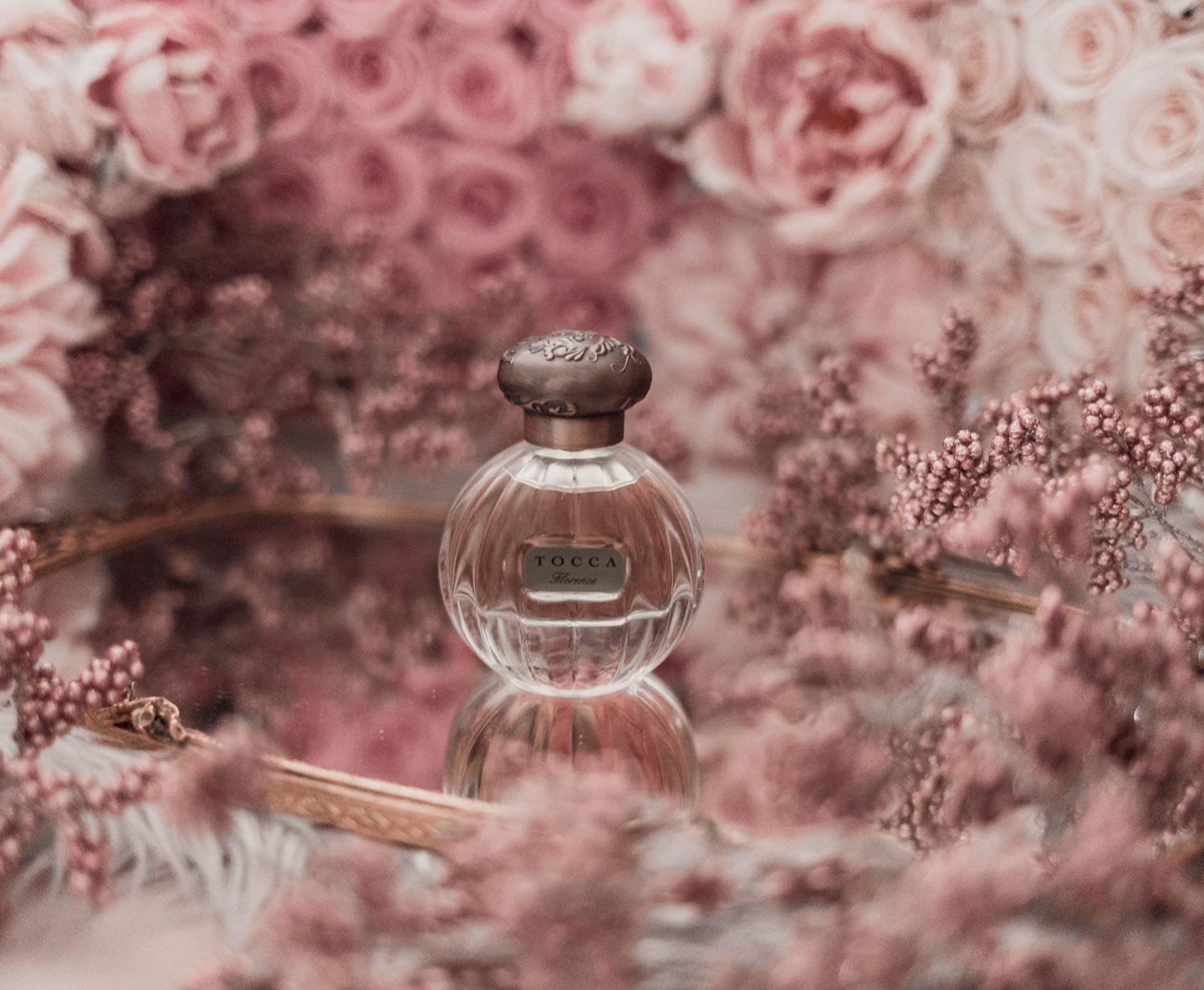 Feminine fashion blogger Elizabeth Hugen of Lizzie in Lace shares the best feminine perfumes and her girly fragrance collection including Tocca Florence