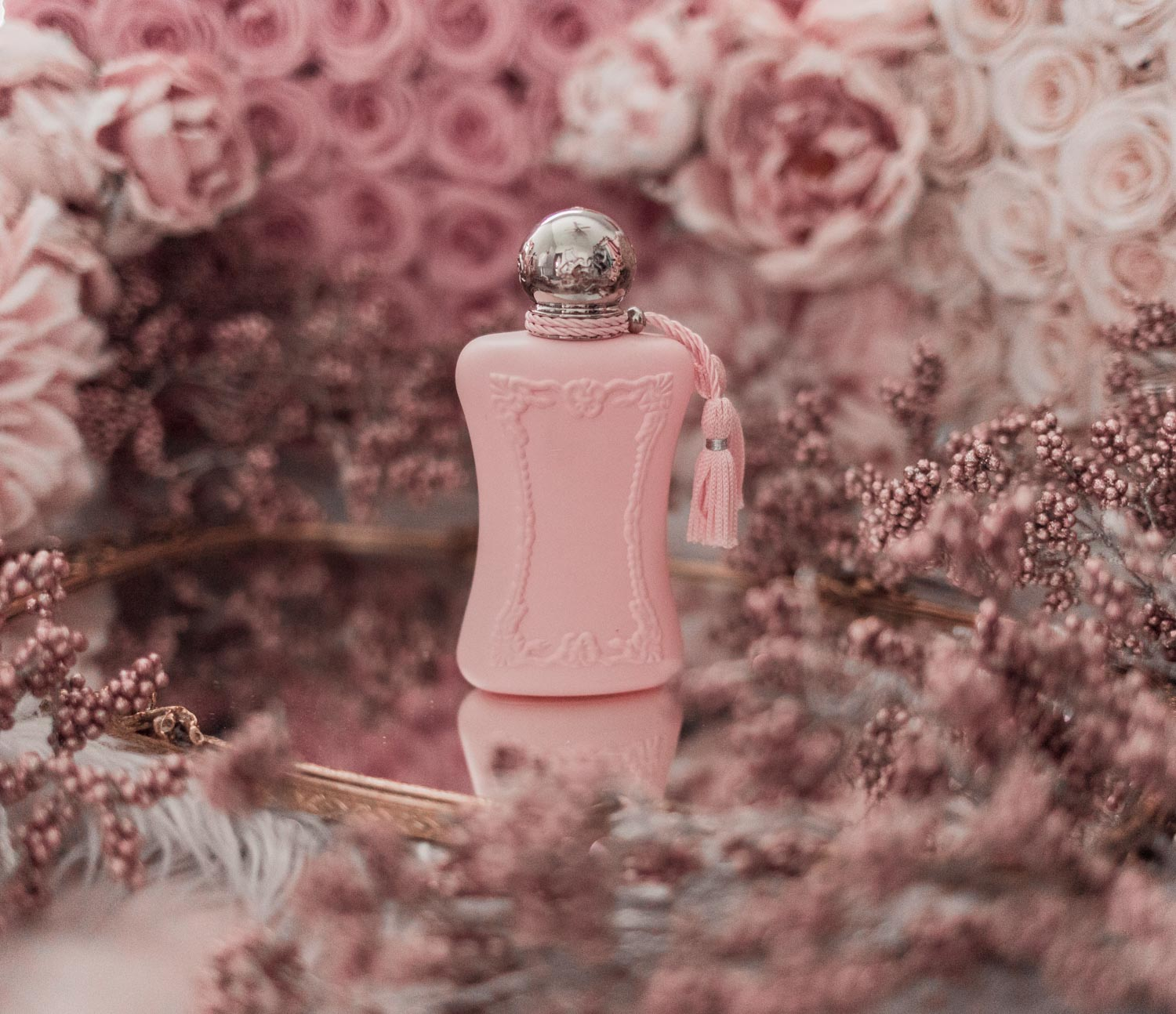 Feminine fashion blogger Elizabeth Hugen of Lizzie in Lace shares the best feminine perfumes and her girly fragrance collection including Parfums de Marly Delina