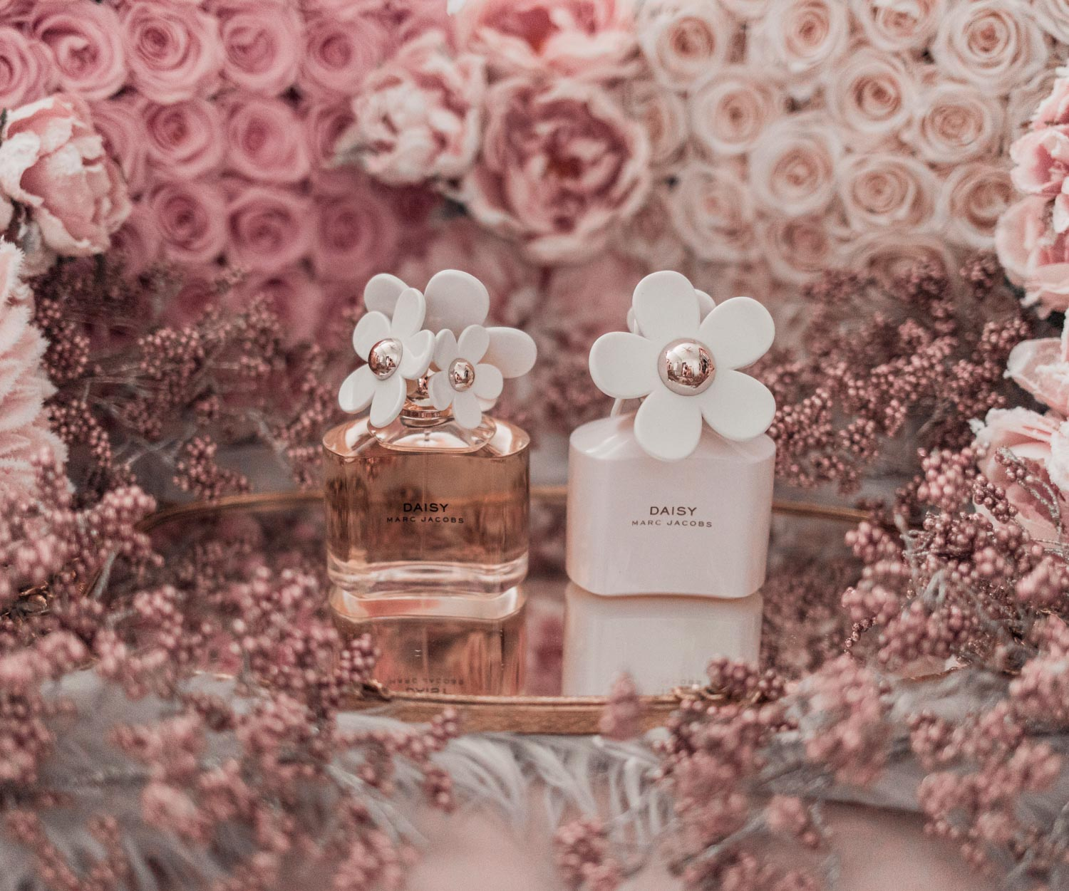 Feminine fashion blogger Elizabeth Hugen of Lizzie in Lace shares the best feminine perfumes and her girly fragrance collection including Marc Jacobs Daisy
