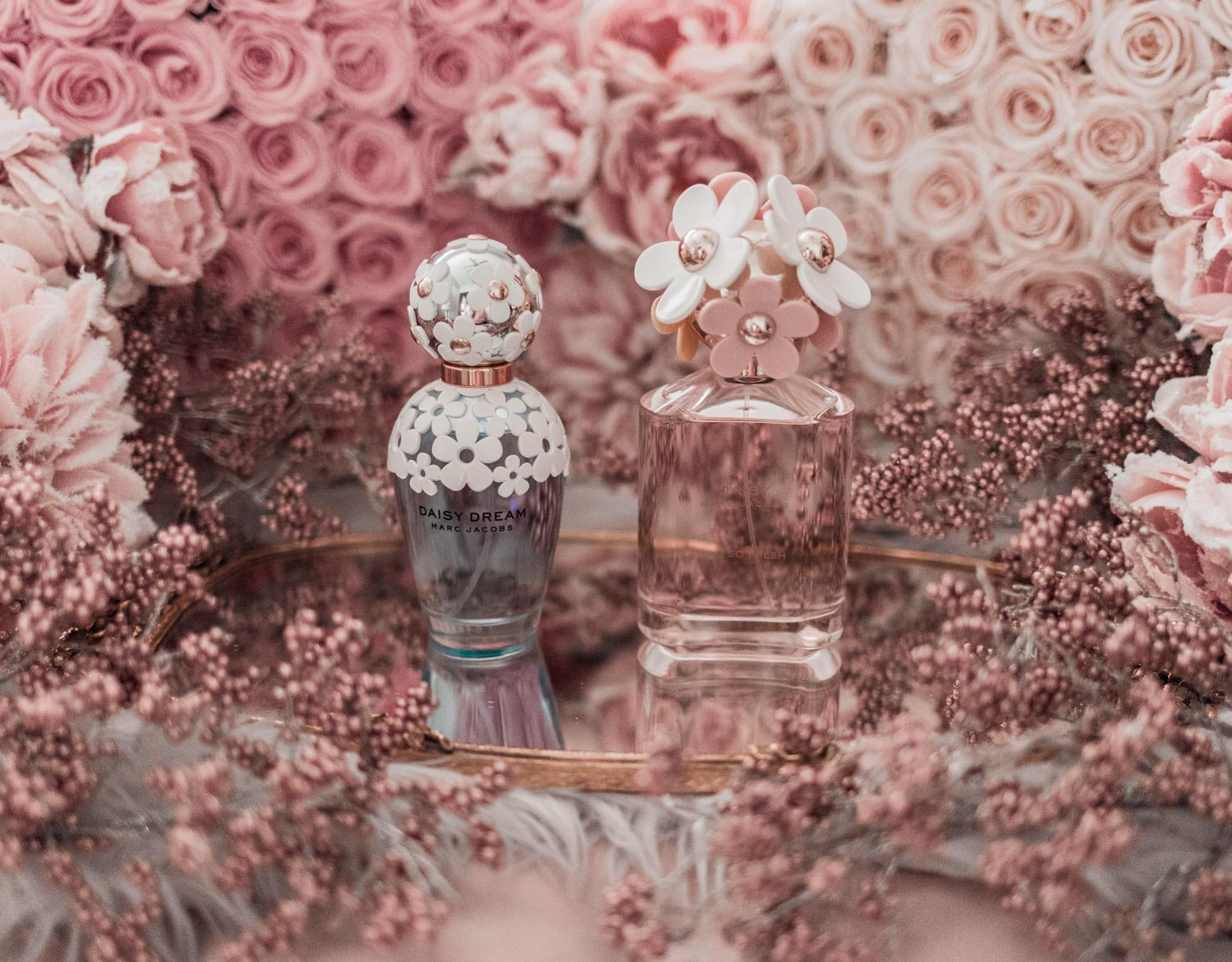 Feminine fashion blogger Elizabeth Hugen of Lizzie in Lace shares the best feminine perfumes and her girly fragrance collection including Marc Jacobs Daisy Dream and Daisy eau so Fresh